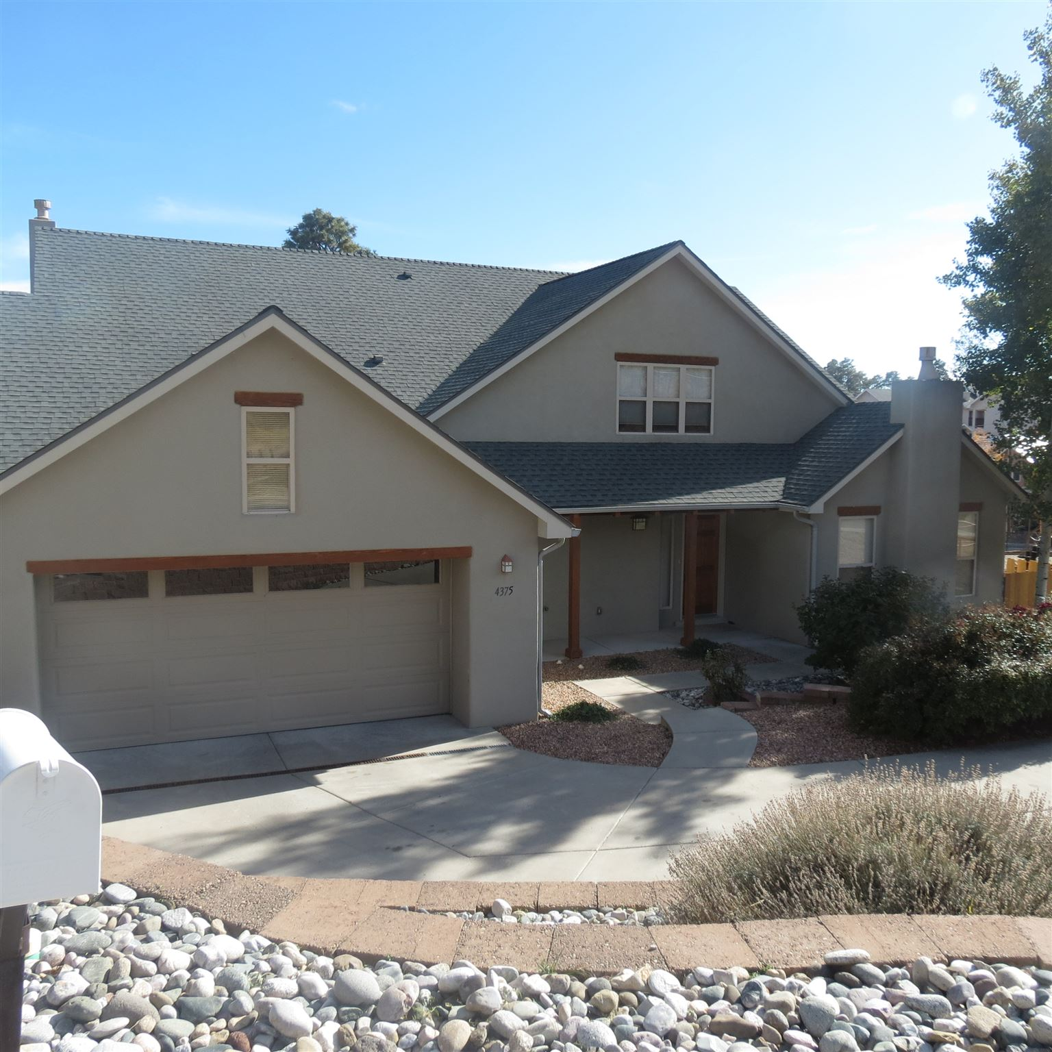 Custom home built in 2004 situated at the end of Arizona Avenue, across from the Mitchell Trailhead and next to Fireman's Park.  The stucco is newer and the roof was replaced in 2018.  Fenced backyard with shrubs, trees and sod.  Larger uncovered patio along with smaller covered patio that provide views of LA Mountain (practically in your backyard!). Front yard is landscaped.  Oversized 2 car garage with heated workshop space.  Inside, engineered wood floors throughout the first level.  Estimate to replace kitchen floor is online and posted in the kitchen.  Cathedral ceiling in Great Room w/gas fireplace.  Open floor plan w/large dining area.  Kitchen features cherry cabinets, granite tile counter tops, stainless steel appliances, an island, pantry, and desk.   Laundry Room, full bath and bedroom round out the lower level.  Upstairs all new carpet, Jack-n-Jill bedrooms w/bathroom in between and large master suite with huge bathroom and walk in closet with closet system.  Fresh paint throughout the house.  Light and bright, this house feels good.  Come check it out today.