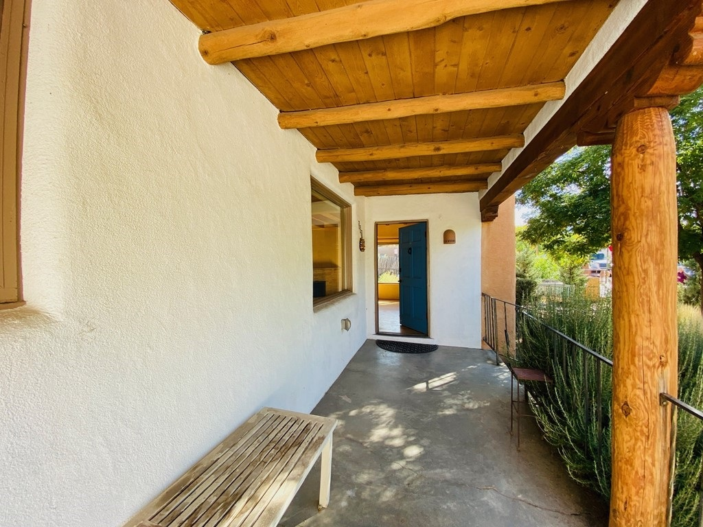 Wanted: A Creative Buyer Who Loves Santa Fe's Historic Eastside Premier Location! Imagine the Santa Fe River Park as your neighbor. Now imagine living in an authentic Santa Fe ADOBE Home with an attached Gallery or Studio a block from Canyon Road's Art World. Next imagine having RARE PARKING downtown for 3 vehicles! This Santa Fe style home is [3BD 2BA Fireplace, Vigas/Beams, AC @1428 Sq Ft with Parking PLUS Attached Gallery/Studio/Office @579 Sq Ft with Stone Floors, 3/4BA, AC, Separate Entrance & Parking]. The home floor plan centers around entry/living/dining room/kitchen open concept with wood-burning fireplace. The chef's kitchen is at your service with a window overlooking the park. All three bedrooms have hardwood oak flooring with tile in the baths. The large walled flagstone patio courtyard adds space for entertaining friends and collectors, sipping a latte or just daydreaming. The property is landscaped with creative xeriscaping adding beauty and privacy. The location is beyond Prime for Santa Fe and a staggering opporunity at $899,000. Schedule your showing soon to experience this opportunity. The next move is yours!