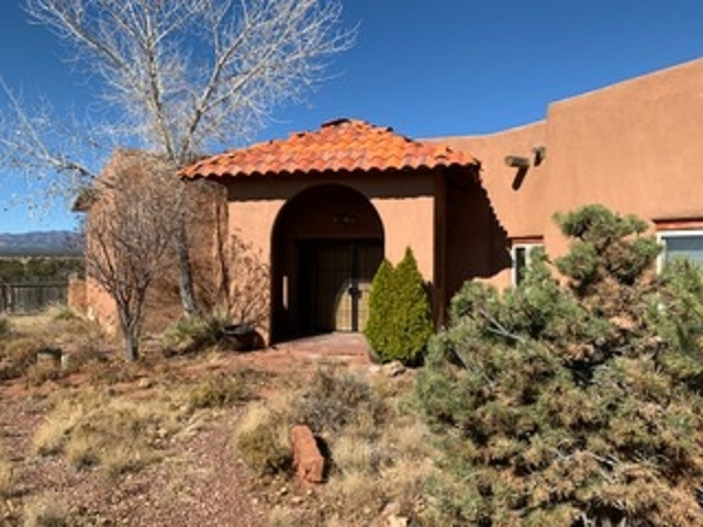 """WOW, major price reduction! Interesting and unique ranchette situated on 30 acres just West of the central New Mexico town of Mountainair. Majestic 2800 square foot house with soaring ceilings and custom touches. Open concept plan with easy flow to all living areas. Large Master Suite and Ensuite Bath with sauna that has views of the surrounding mountains. Sits high on a hill with great views in all directions. Detached workshop/garage. Private well with great production of """"sweet water"""" that amply feeds a storage cistern for consistent water flow. While this property needs work and is sold """"as is"""" it has great potential for a family wanting a great horse property, or someone who wants to create a conference center/retreat . Motivated Seller is ready to move this property."""
