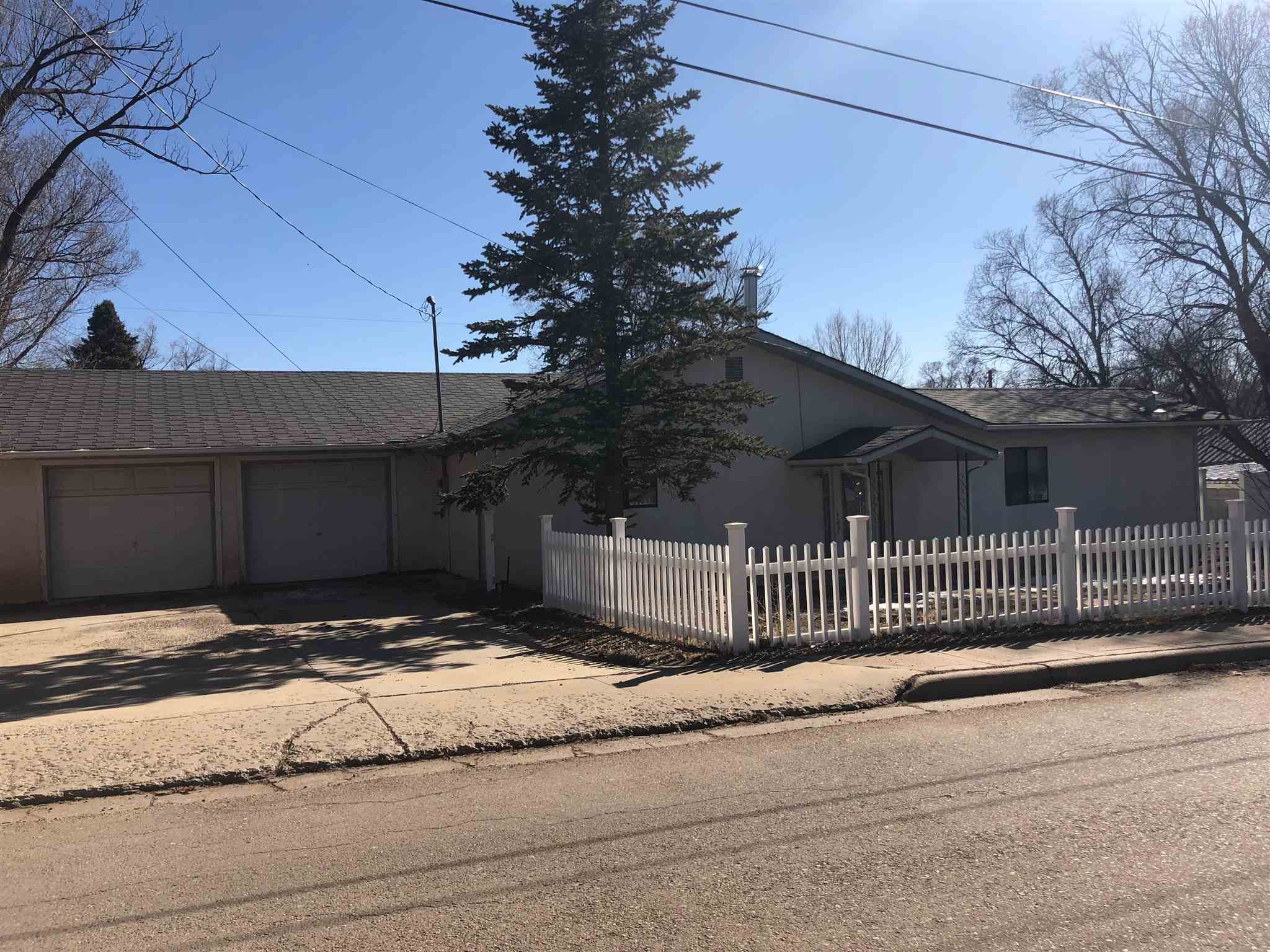 This large 4 bedroom, 2 bath house with a 2 car garage attached could be yours today. With some TLC this place offers great potential with a central location. On 1 acre of property this home offers a large lot to make your own. Fenced and has storage buildings in place.