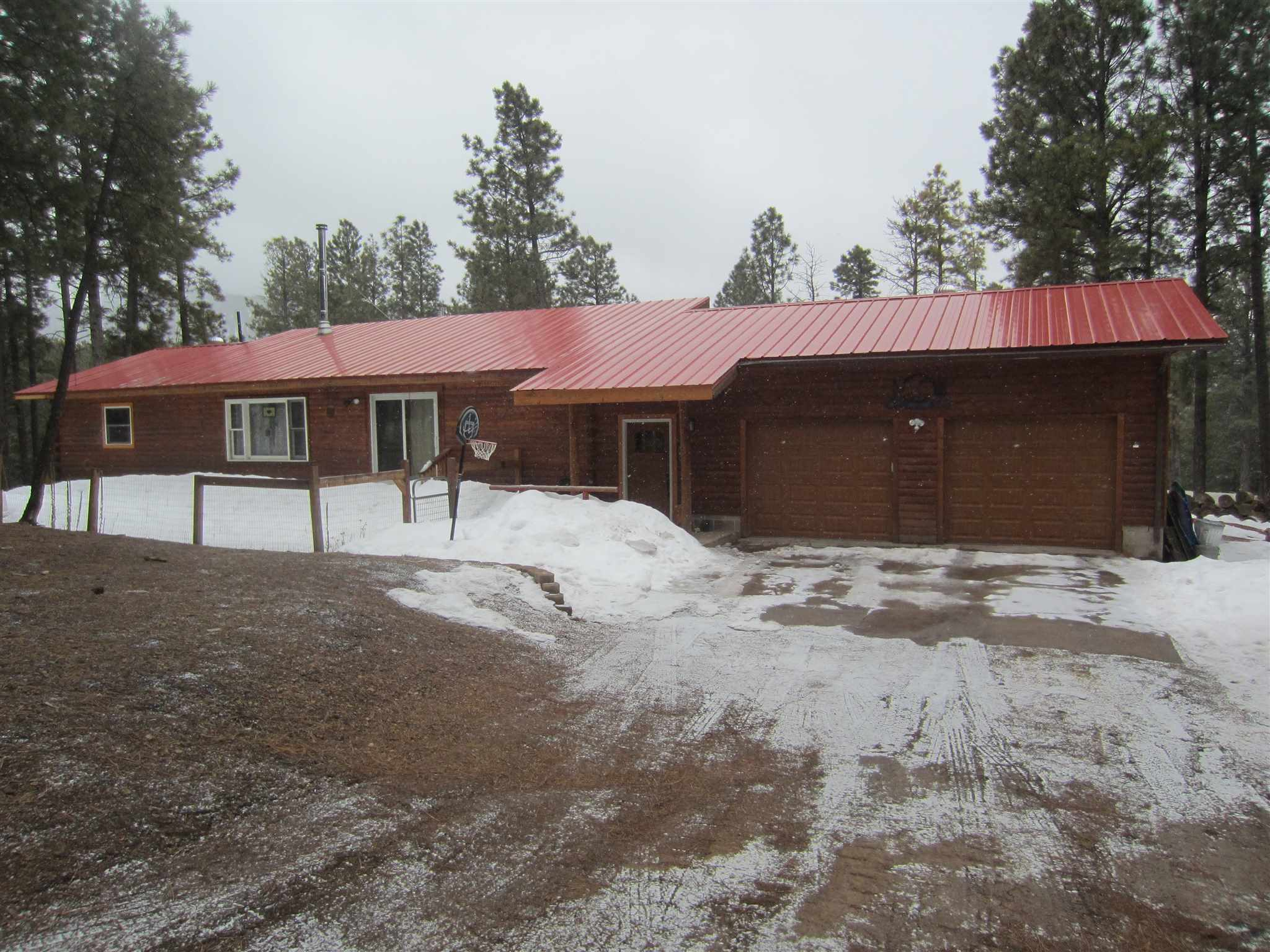 Jemez living never looked so good!  This well maintained home is right off of State Road 4, making it an easy commute into Los Alamos, or the Jemez Valley.  Over 1,600 square feet offers an open living area with higher ceilings, letting in tons of natural light.  Three bedrooms, two bathrooms (one recently updated) are just the beginning of what this property has to offer.  With a large front deck, mud room, and an oversized two car garage, this property is mountain living at its finest.  This house has potential to be a horse property (coral and out-buildings), or, outdoor space could be modified to meet whatever your needs may be.  You won't want to miss it!