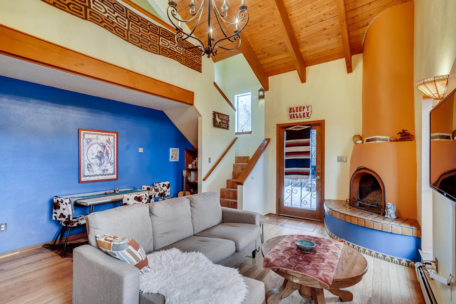 Come fall in love with one of the best values in Santa Fe!  This end unit townhouse is chock full of features that typically come with a much higher price tag attached.  Mountain views, kiva fireplace, clean stainless steel kitchen appliances, saltillo tile and wood floors, fantastic separation of bedrooms, ample storage spaces and many tasteful custom features adorn the interior of this 2 bed, 2 bath home. A private balcony off the master suite and the beautifully appointed master bath grant a humble elegance to the upstairs master suite. Outside, the yard space is home to productive apple and apricot trees, and a running water feature to keep life beautiful and serene.  This could be a great home and/or a fantastic investment, schedule your showing today!