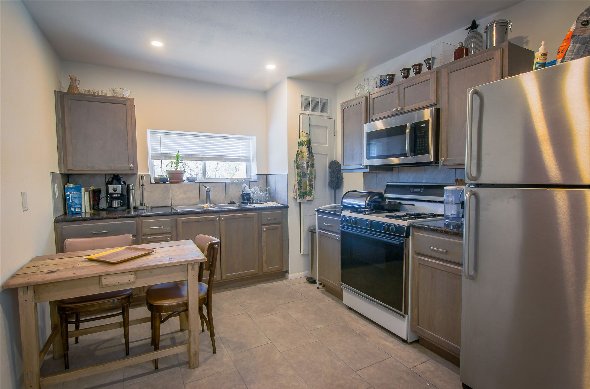 A tremendous opportunity for an investor or buyer in a prime location. Just a short walk to the plaza, restaurants, and shops. Recently upgraded home with large open lot. A must see! R21 zoning; many possibilities. The house has had updates and in good condition.