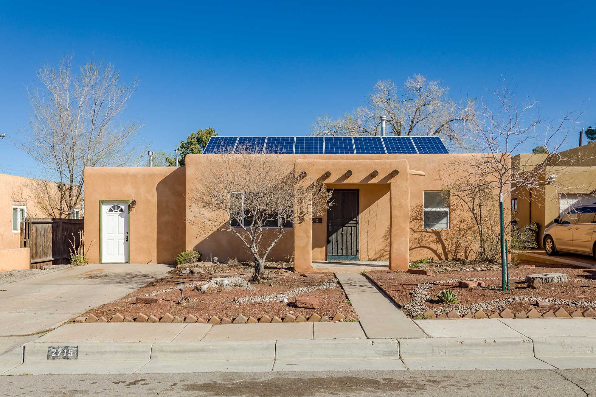 Fabulous 3 bed/2bath home near UNM, CNM, and Nob Hill! Move right in and enjoy the spacious front and back yards. Features include: Solar PV panels; hardwood floors; cove ceilings; large living room; 3rd bedroom could be used as office with separate entrance or den; covered backyard patio.