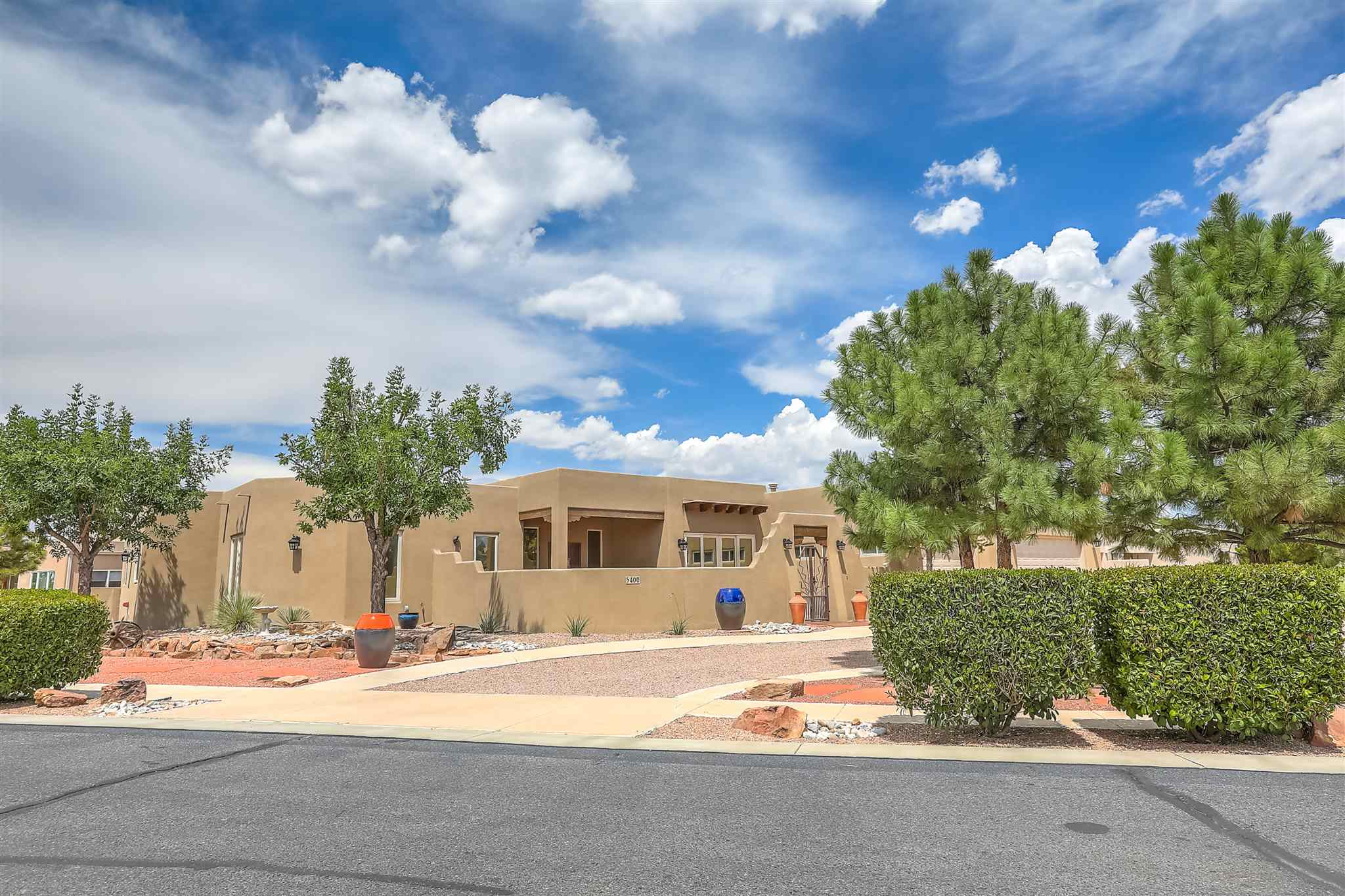 Fabulous location in this beautiful custom Pueblo home located in a premier Old Town gated community called Gardens on the Rio Grande. Walk to hiking, bike trails, museums, dining and retail. Close to Downtown and I-40 at Rio Grande. Easy access to the freeways! Enter the private gates to the interior courtyard with decorative fountain to the over sized entry. This home boasts two master suites perfect for those who want the extra space. Each master has a private over sized bath and large closets. Great room is over sized with fluid floor plan to outdoor patio, formal dining and kitchen area perfect for entertaining. Formal dining area opens to front courtyard for indoor/outdoor parties. Back patio is extended for summer enjoyment and looks out to the common area green space. Three car over sized garage includes extra space for small work-shop. Mature landscaping provides you an oasis right in your own back-yard with automatic bubblers! This is a great home that lets you lock and leave - or treasure every moment inside.