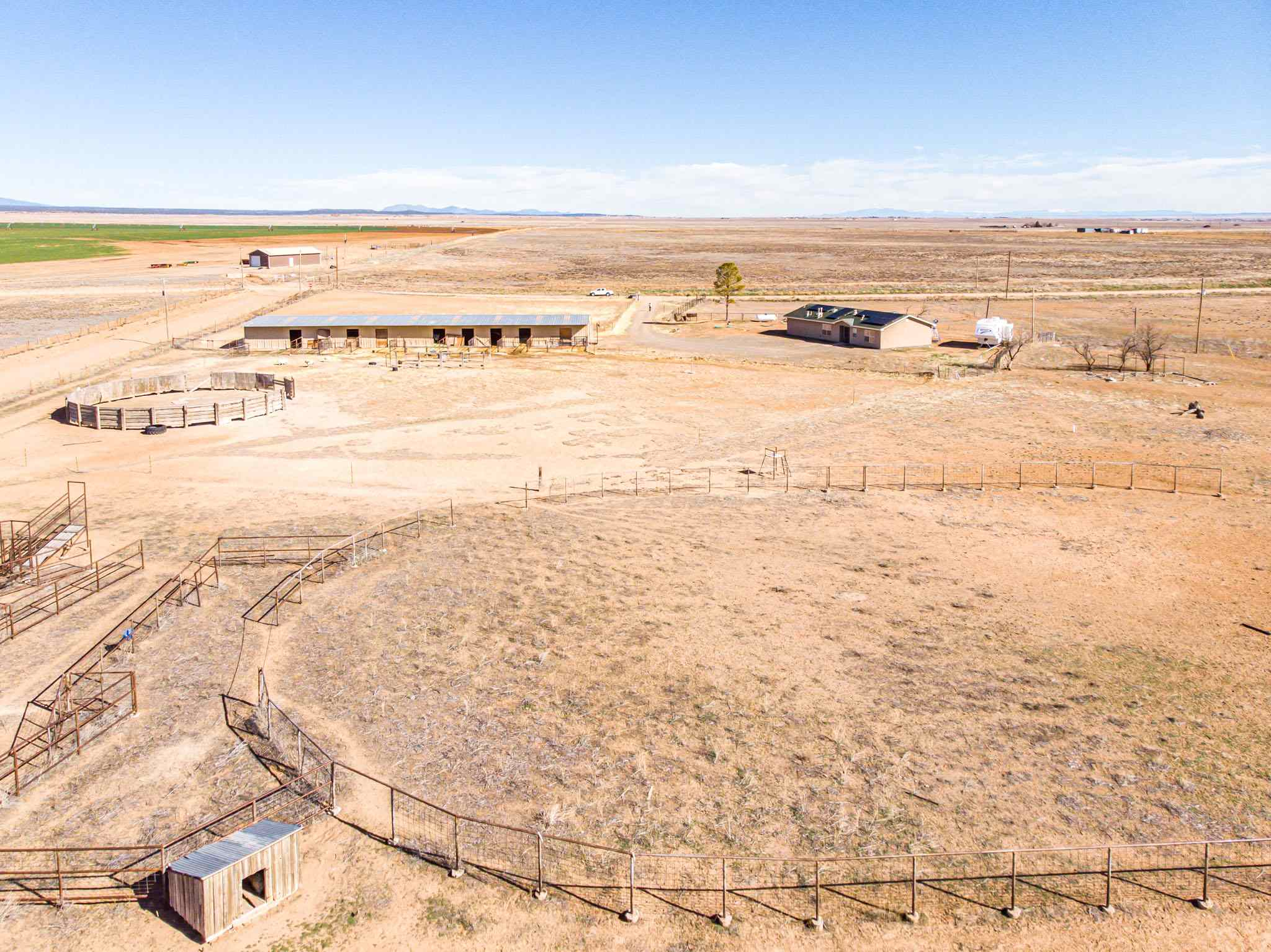 This New Mexico 40-acre equine property with a 1620 sf home features an 11-stall barn with hay storage, holding pens and riding arena. The 40 acres is fully fenced and cross-fenced and has good grass for horses to graze. Property is located just west of Estancia in Torrance County. The home consist of 3 bedrooms, two bathrooms, lovely master suite and a nice country kitchen. The Manzano Mountain views are magnificent especially at sunset. Solar panelson the roof make the home energy efficient with low electric bills. Albuquerque is about 60 minutes away and Santa Fe is roughly 90 minutes.