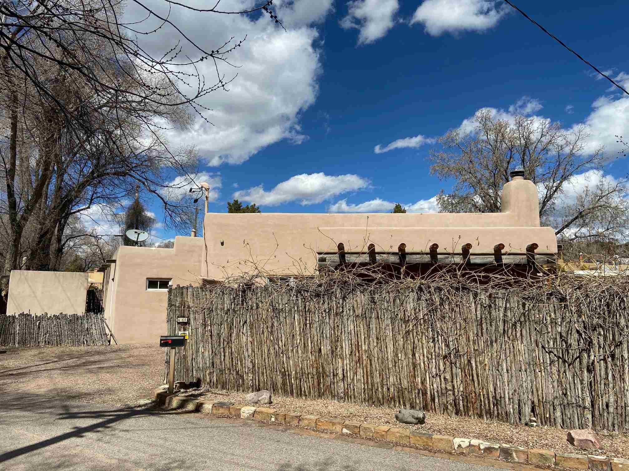 NEWS - Your 24/7 Virtual Open House Right Now. This is a new on the market opportunity for you if you treasure Santa Fe and imagine living here in a custom fine home on the end of a quiet street close to the Historic Plaza on the north side of town. Inside the gate, you will enter a sunny courtyard and a Santa Fe Style custom home filled with light, a Eurostyle gas kitchen, kiva fireplace, open concept living designed for humans who cherish a smaller space to live or for a retreat. This is one of three homes in Las Rosas. This one has A/C, high speed cable, 2 off street parking spaces a roof warranty for 10 more years and city utilties. PLUS - this home does qualify for conventional financing. Enjoy your tour. Schedule your consult today. See Virtual Tour.