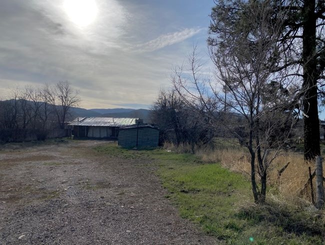In the heart of Chama and close to restaurants and shopping.  Home is not habitable but the land is ready for whatever you would like it to be!  Potential commercial business or residence.  City utilities available and property has a private well.  Within a couple of miles from the Cumbres and Toltec Scenic Railroad.