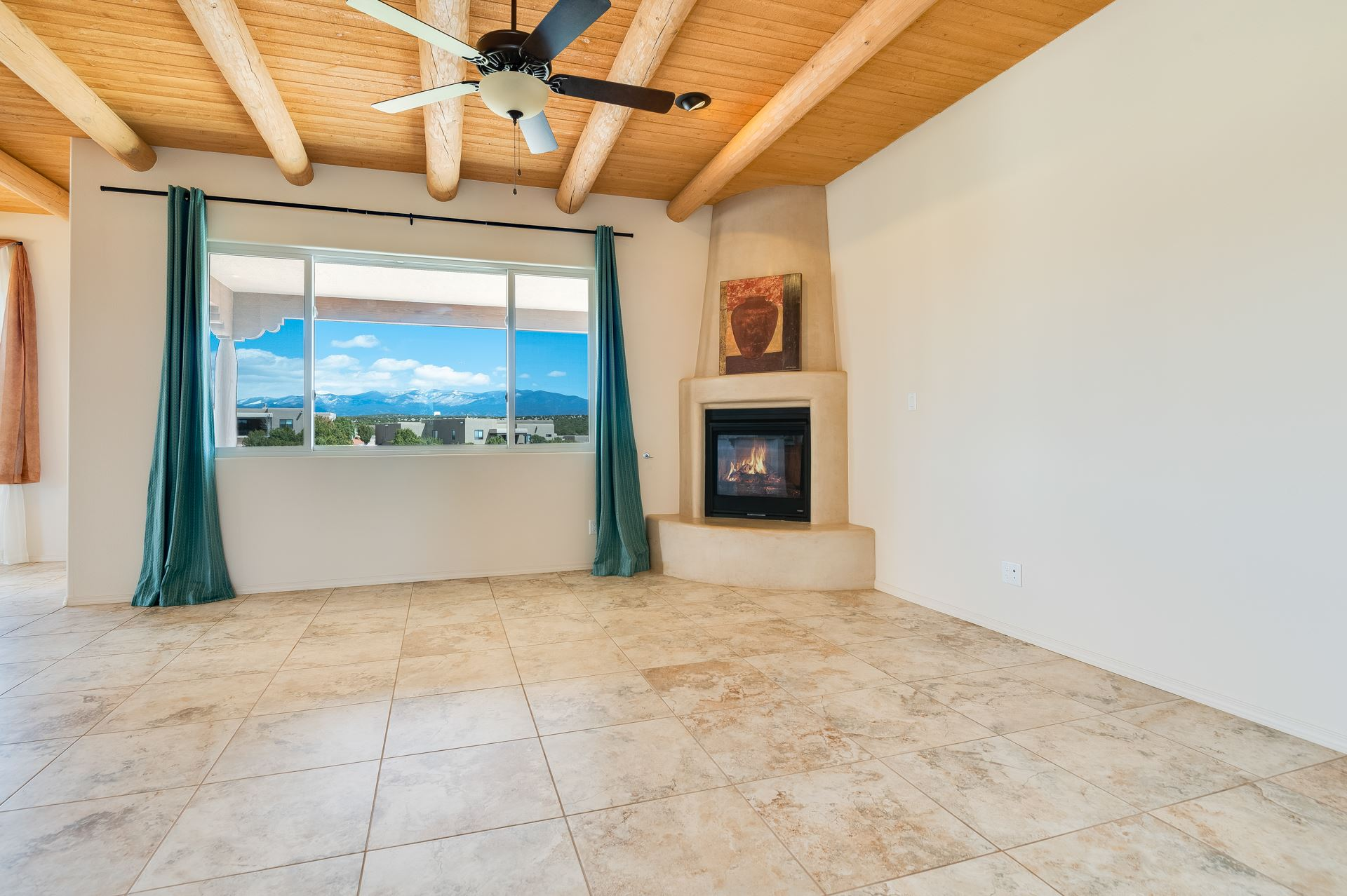 Looking for an affordable view property? This is it---located in the spectacular community of Tessera, this lovely, all single level three bedroom home sits perched on one of the highest lots in the subdivision and features truly staggering Sangres views (photos will never do these justice!). Built in 2015, the property includes vigas and beams, corner fireplace in great room, upgraded countertops and deco tiles throughout, granite and stainless cooks kitchen with full pantry, designer lighting , spacious master with en-suite bath replete with double sinks and spa tub, direct entry two car garage with spacious utility room. Added bonuses?  Full length rear portal and covered deck overlooking rolling terrain and stunning eastern vistas, three mini-splits for controlled indoor cooling, efficient drought tolerant landscaping, and low HOA fees.  Mere minutes to the 599 interchange and a wide range of services, Tessera boasts six miles of interior walking trails and the La Tierra trail system is just a mile away.