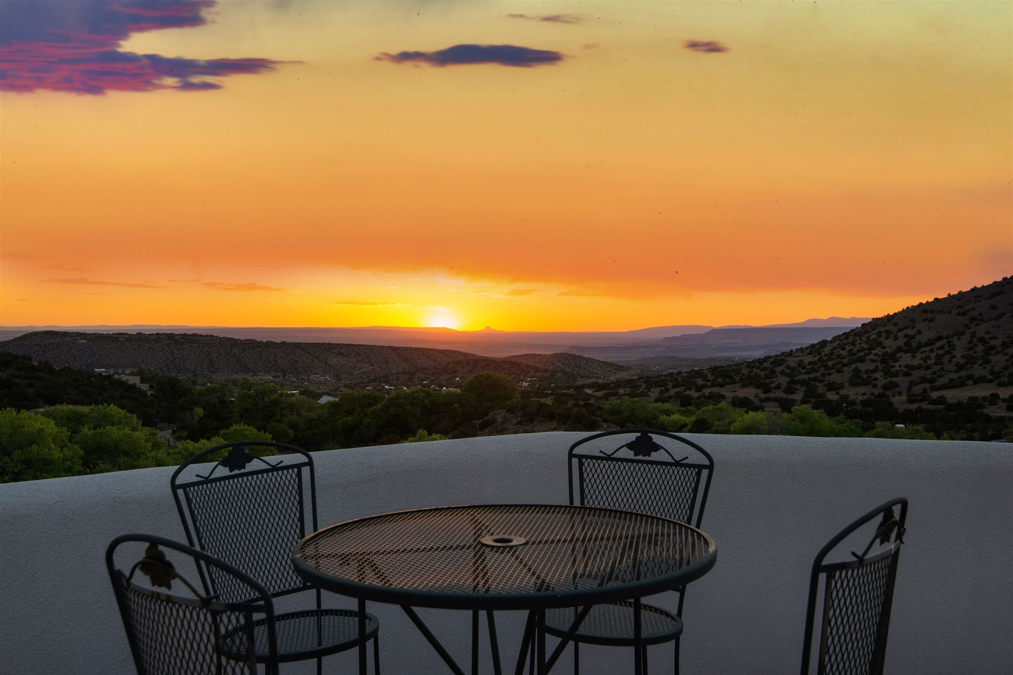 Nestled in the foothills of beautiful Placitas, this stunning custom-built home offers breathtaking, one-of-a-kind views of Cabezon Peak, the Rio Grande River Valley, and the Sandias. A private and tranquil sanctuary that features rounded window walls and magnificent viewing decks to capture the spectacular views that surround this captivating property. Beginning with its gated courtyard entry and continuing throughout the home, the builder's masterful architectural details, including vigas and beams, are spectacular!  This magnificent property features a formal living area with a kiva fireplace; a formal dining area with a coved beam ceiling and gorgeous hardwood floors; an open concept family room integrated with a spacious kitchen featuring granite countertops and spectacular Cabezon views; a separate downstairs office; a large master suite with tongue and groove ceilings, and a large walk-in closet, Jacuzzi tub and views of the Cottonwoods of Del Oso; and two ample size guest bedrooms with an additional full size bathroom. Easy commute to both Albuquerque and Santa Fe. With lots of natural light throughout the home and multiple living spaces that feature the beautiful outdoor surroundings, the peace and tranquility of life in Placitas can be yours!