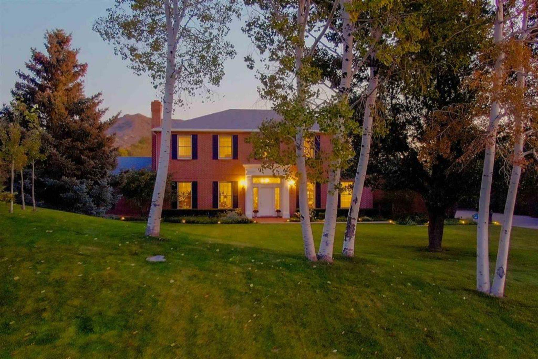 Sophisticated quality! Classic elegance in impressive custom-built brick home & gardens in Albuquerque foothills—perfect for comfortable living and entertaining inside & out. Views of Sandia & Manzano Mountains. Two huge living areas, one on each floor. Separate dining room. Master suite on first floor. Stunning architectural setting for all styles! Exceptional, one-of-a-kind details: 9'' crown mouldings, antique working fireplaces in formal LR & DR. 10' ceilings on 1st floor. Hardwood floors throughout. French antiques in kitchen cabinetry. Lovely gardens designed by landscape designer Bill Hays: 65' patio consisting of 2 Italian pergolas with parterre garden & fountain. Just like walking into Architectural Digest! Completely remodeled in 2015. Everything like new & meticulously maintained.