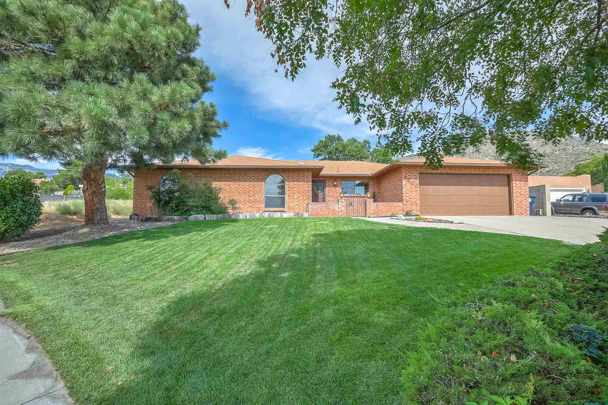 Lovingly cared for one-owner, single level brick ranch in the Foothills! Cool off from the summer heat in a lush backyard oasis with gunite swimming pool, west facing covered patio, and mature landscaping. Inside there are 4 generous bedrooms, 3 bathrooms, great mid-century structure with connected living and dining room, and huge family room with wet bar.  Family room french doors provide excellent flow out to the back patio - perfect for entertaining guests or relaxing family evenings.  Property backs to open space with views both east and west. Incredible potential!