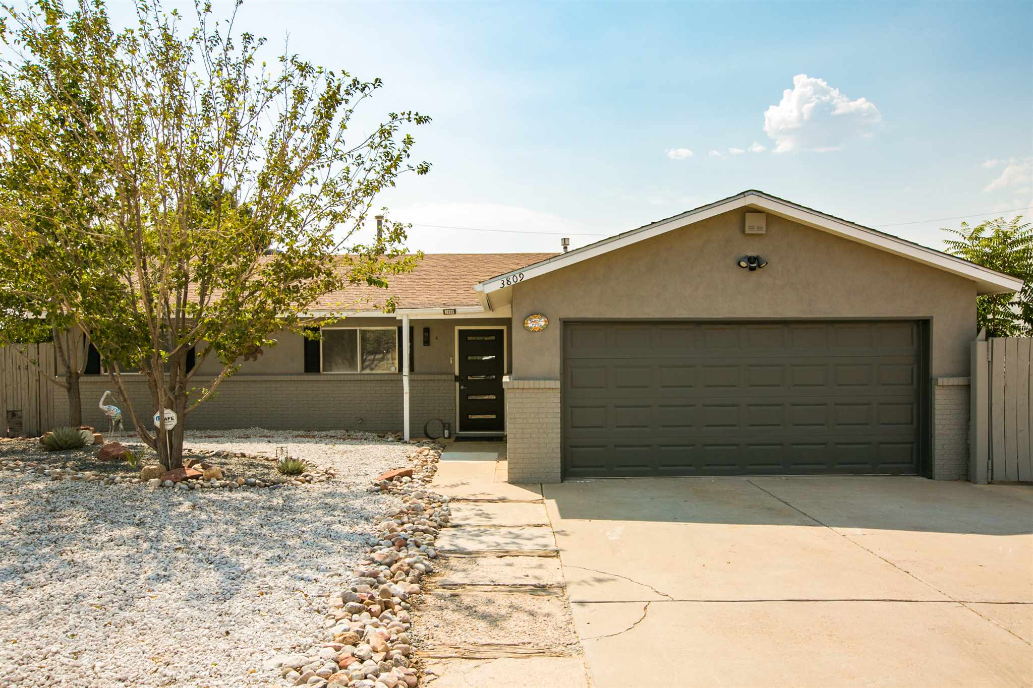 Featuring a well maintained 3 bedroom 2 bath home sits on a .22 acre lot and offers an open floor plan. New paint throughout, new HVAC system, new front door, tankless water heater,  Panel upgrade, 584 sq. ft. shop rewired, new security porch lights, zero-scaped, new fans in sunroom & great room, with a new garage remote. Beautiful faux wood flooring, bullnose finished granite, and cultured marble surround showers. A spacious great room has a warm and tranquil retreat with wood finished ceilings and walls, comfortable bancos and a kiva pellet stove to provide relaxation, rest and entertaining. Great central location to all ammentities.