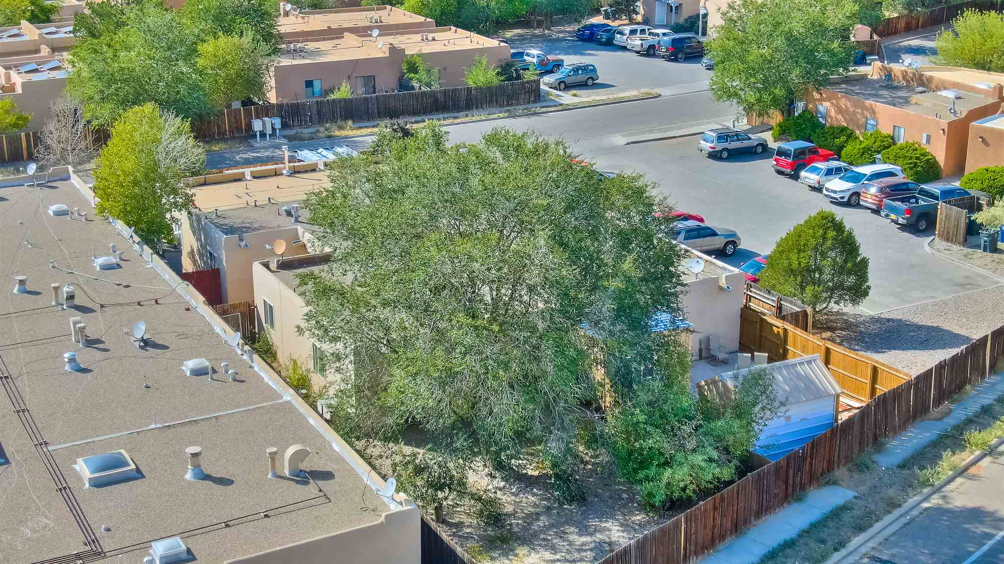 Large fenced Backyard, 2-Bedroom, 1.75 Bath Condo on a single level.  Property has been rented for several years.  The unit does need work.  Apple tree in back yard.  Newer water heater in 2016, newer toilets in 2018, paint and carpet newer in 2017.  Off street parking.  Radiant heat without a cooling system.  This is an opportunity to make improvements to the property.
