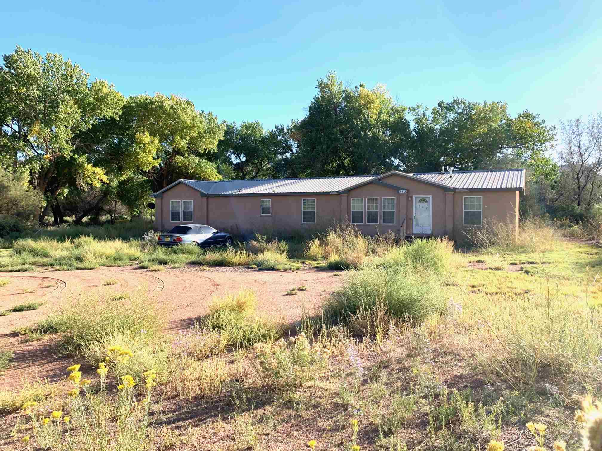Nice 3-bedroom 2.5 bath manufactured Oak Creek home with two living areas, office and den off master bedroom. Features include a fire place large separate washer room and open concept living area. Lot is 6.1 acres. Lots of trees in the yard.