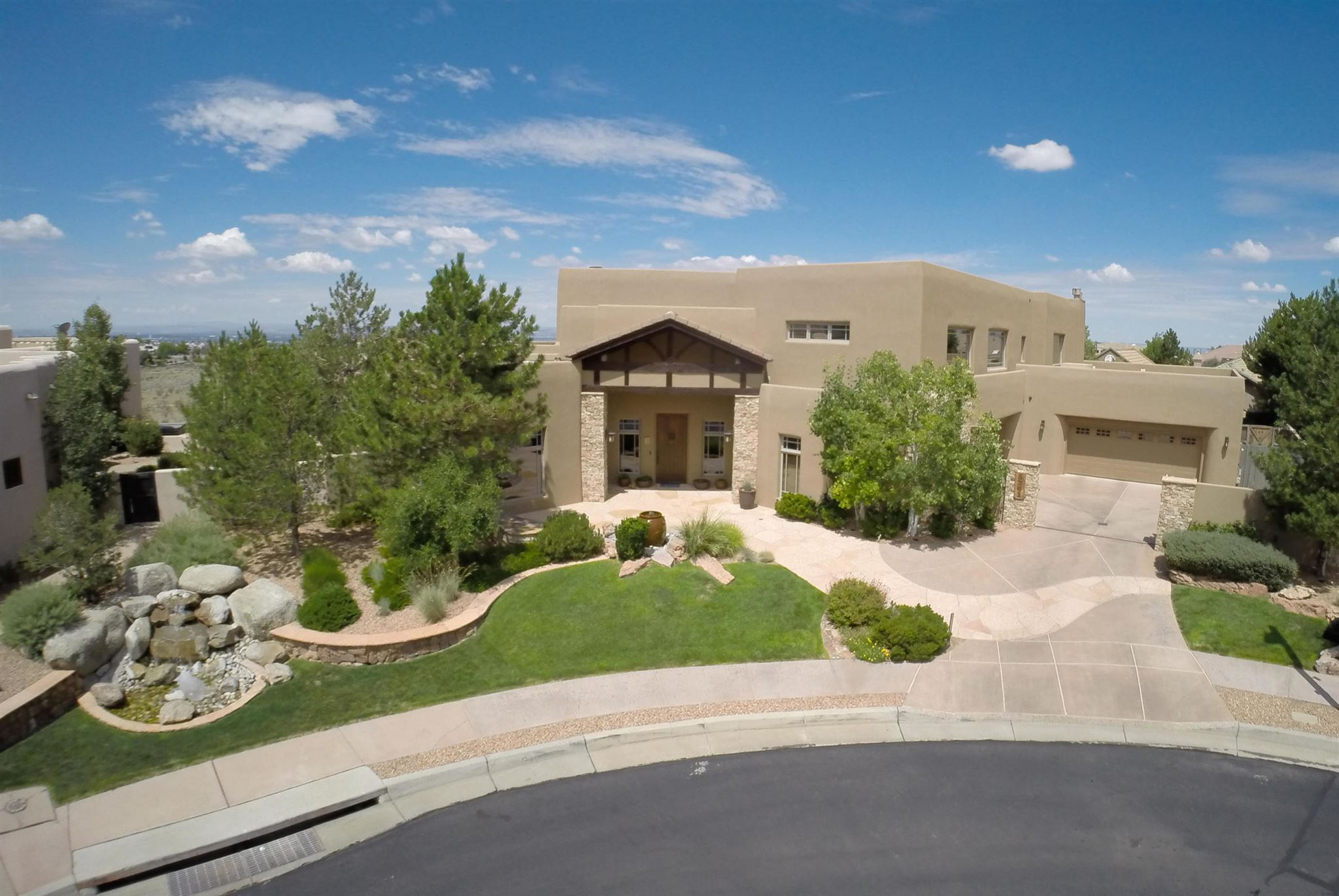 This phenomenal custom Craftsman style residence located in The Canyons at High Desert, backs up to Bear Canyon Open Space. Phenomenal city and mountain views leave you awestruck at New Mexico's lavish beauty. The exterior is impeccably landscaped and includes a heated pool & spa, fire pit, garden, koi pond and waterfall. The interior is magnificently designed and features wood truss ceiling, 3 fireplaces, 2 laundry rooms (one in master closet), professional kitchen & multiple entertainment spaces. This one of a kind, unique home is welcoming and provides ample space for family and entertaining. Aerial footage and matterport available! Please see attached supplental information sheet for additional home features. (Photos from previous listing utilized with permission) Audio/Video present.