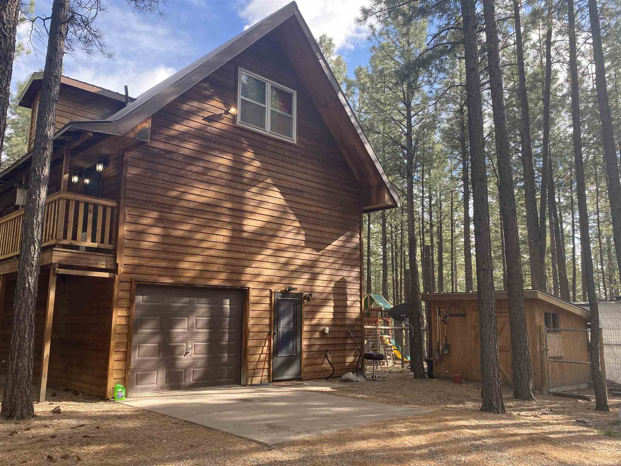 Just a short beautiful scenic drive from Los Alamos sits this amazing mountain home located among the ponderosa pines.  This 3 story gem features 4 bedroom and 2 bathrooms as well as a large workshop and bonus room on the garage level.  The large wrap around deck, fenced in yard and large chicken coop are just a few more features that make this such a great find!