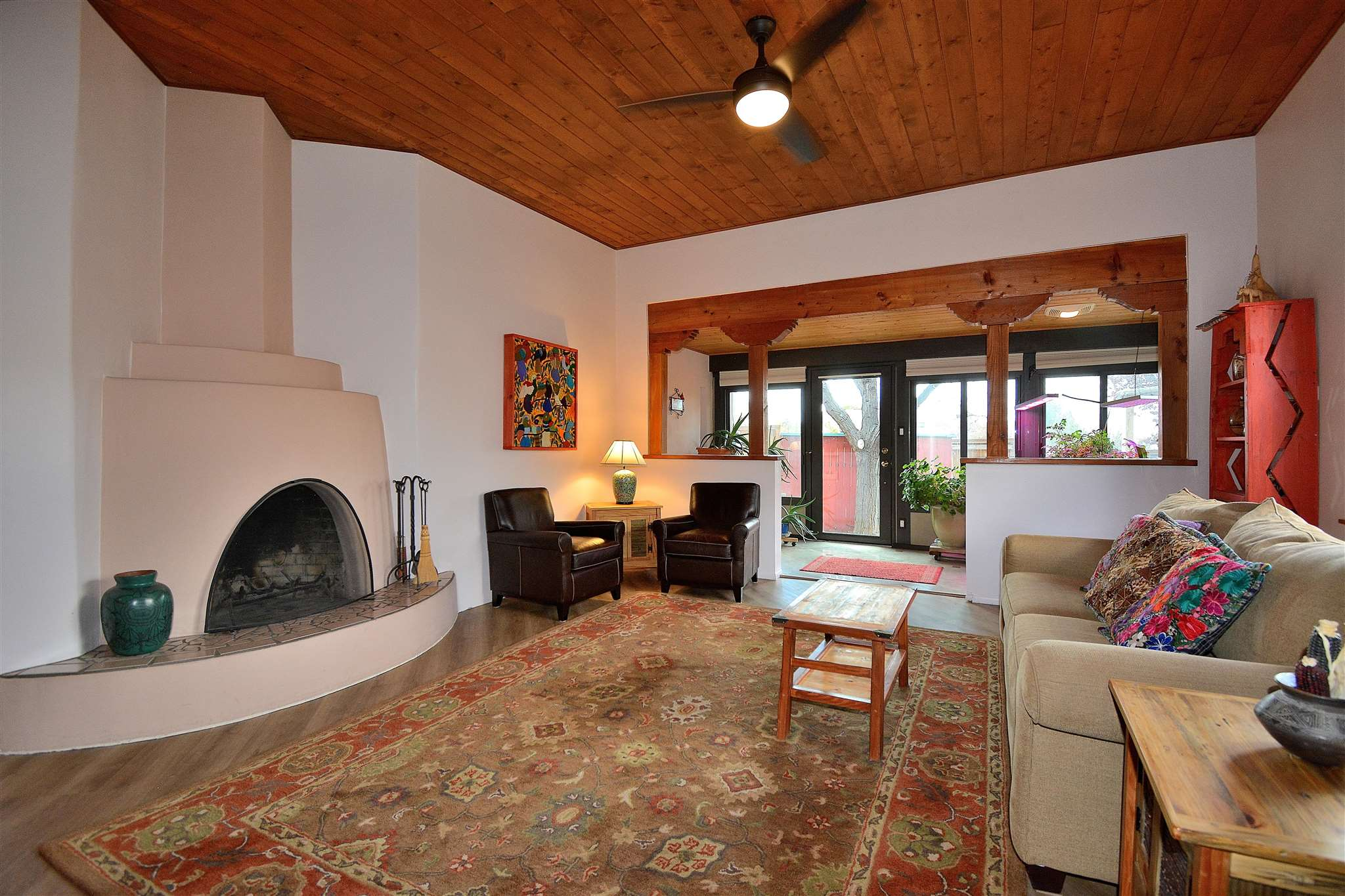 Don't miss this magical, Santa Fe style, single story, single family home in Park Plazas. This home is well-loved and immaculate. Full of light, there are eleven skylights, four in the heated garage and seven inside the home. The flooring in the living room, dining room and bedrooms is new, high quality, luxury, wood-look vinyl. The entry, kitchen, breakfast area and sunroom are tiled. The ceilings in the main living areas are high and beamed. All of the window shades are newer. The house is cooled with two window air conditioners, ceiling fans and a whole house exhaust fan in the garage. Outside is landscaped with a fountain and goldfish pond, grape vines, a raspberry bush and an apple tree with three different types of apples. The sitting area is idyllic and the hot tub tops off this wonderful house with luxury. Park Plazas is centrally located in Santa Fe and offers an oasis-like setting. There are miles of walking trails, tennis courts, off-leash dog park, community garden, and children's play areas. There is also a gated area where residents can store their large vehicles or RV's.
