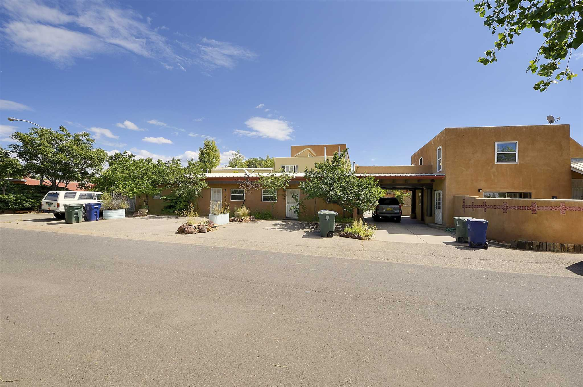 Great investment opportunity for rentals located near the heart of Santa Fe. Part of an 8-unit condo association, this offering is comprised of 5 units, four of the units are single story, and one is a two story unit. The 2-story unit has 2 bedrooms and 1 bathroom, laminate and tile flooring and hot water baseboard heat. Both bedrooms and the full bathroom are upstairs. The main bedroom, with a large cedar- lined closet, has access to roof top deck with views of the mountains in the distance. The kitchen has electric cooking and off the kitchen is the laundry room. The other 2-bedroom unit has 2 bathrooms, cozy stone fireplace, covered portal with enclosed courtyard. The remaining 3 units are all 1 bedroom and 1 bathroom, with tiled floors and back splashes, stacked washer/dryer, gas cooking, and forced air heating. All of the units feature tub and shower combos with tiled walls in all of the bathroom, an enclosed small yard, and a generous amount of off- street parking. This property is centrally located near shopping and restaurants, and less that 3 miles to the Santa Fe Plaza, the Santa Fe Children's Museum, and the South Capitol station.