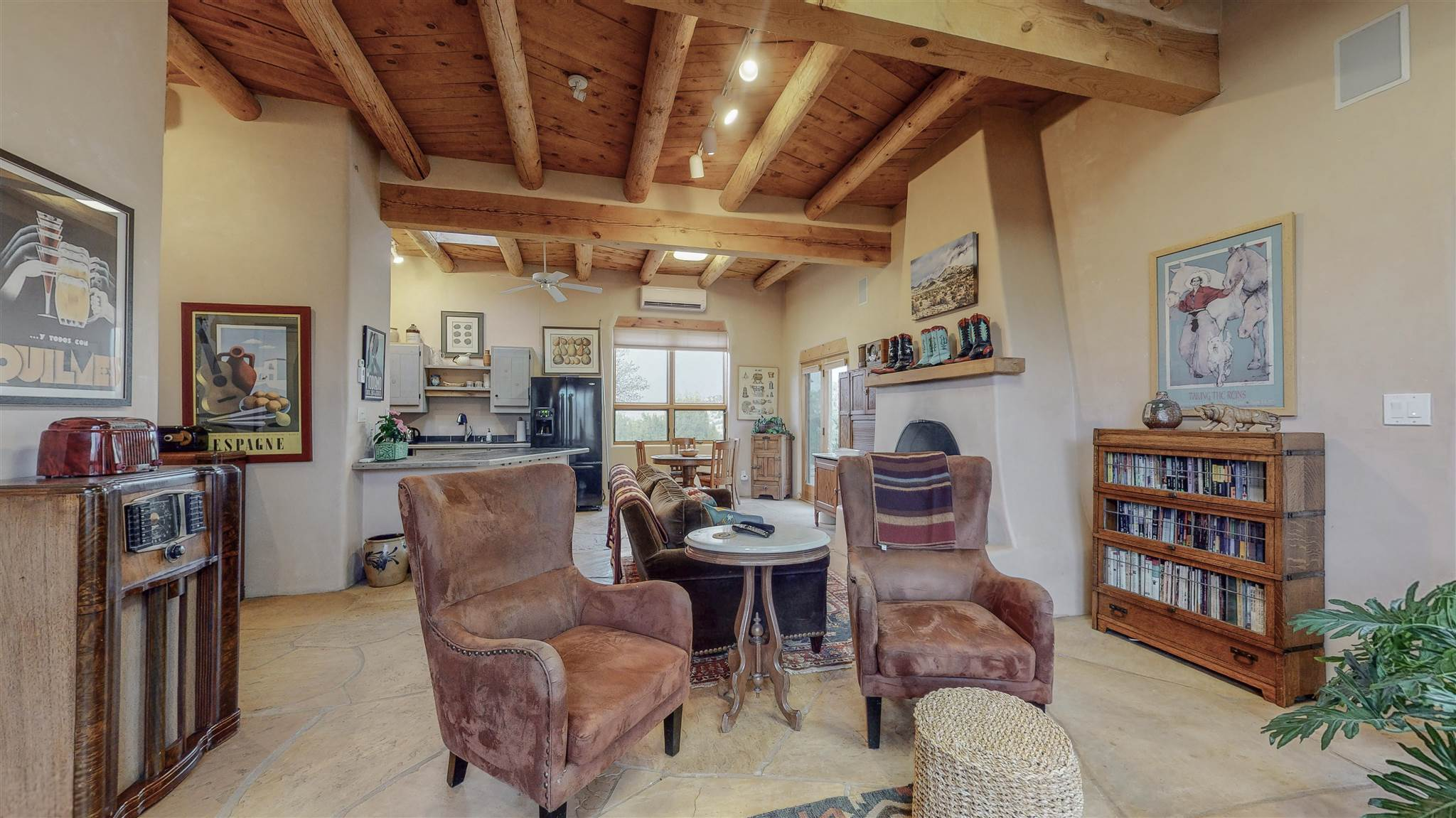 Are you looking for space in your own personal sanctuary? Check out this beautiful custom-built, passive solar Michael Sharber home on 5.8 acres, with views of the Cerrillos Hills and Ortiz Mountains. This fully custom home showcases traditional pueblo style finishes with brick floors, custom cabinets, diamond plaster, tongue and groove ceilings, and beautiful beams running throughout the house. Stay cool in the summers with a mini-split cooling system, and warm in the winters with your Kiva fireplaces and radiant heat. Enjoy your personalized patio and landscaping with flowers, apple trees, peach trees, and local plants.  This property has three additional bonus rooms that could easily be converted into extra living space! Come see this beautiful property today!