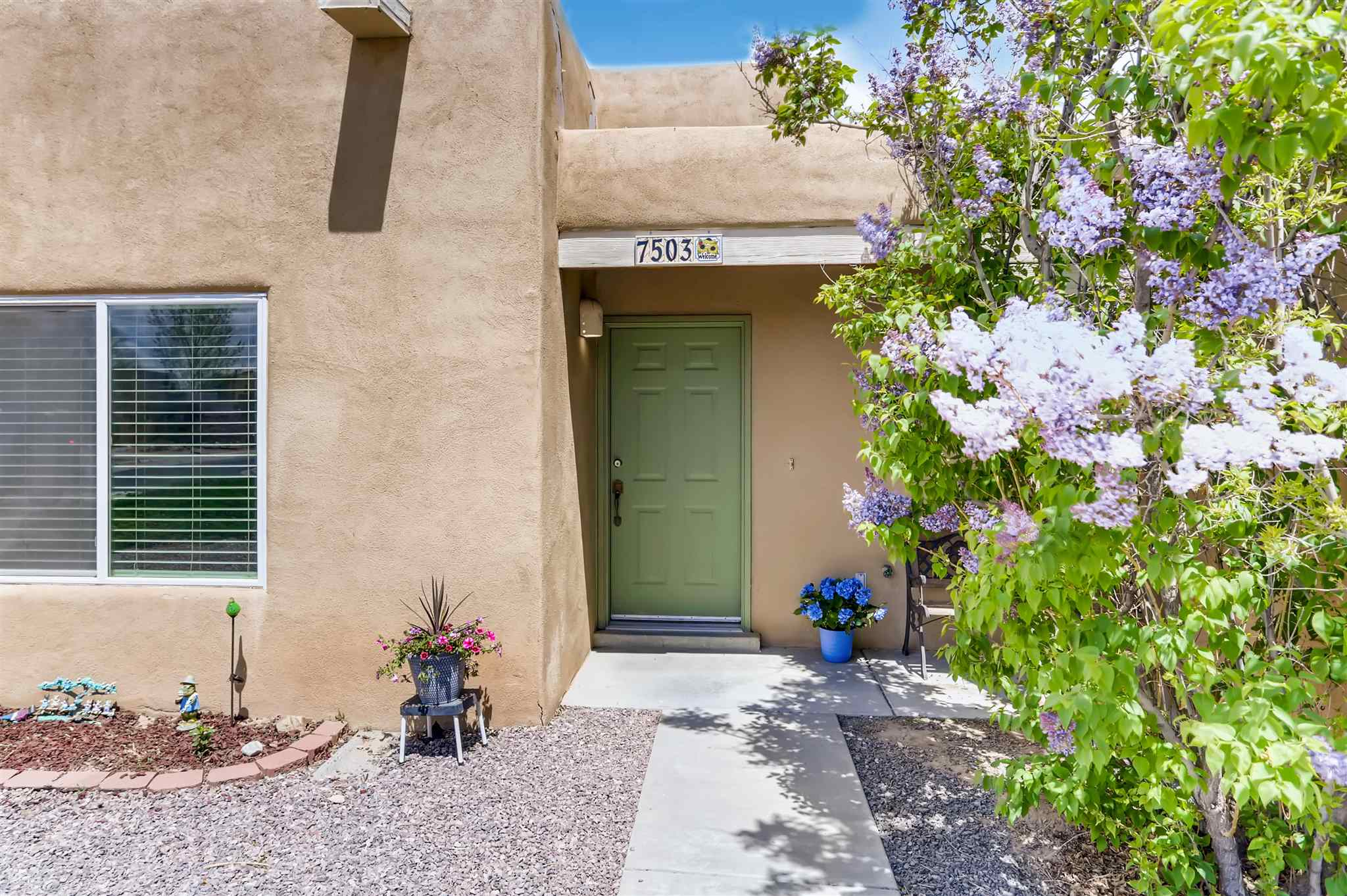 A sweet single level home in the gated community of Vista Primera which features  spacious front and back yards with mature healthy lilac and rose bushes, plenty of natural light, new paint, a gas fireplace, a 2 year roof warranty and Pella windows that were installed in 2015. This property is close to 599 for easy access to downtown Santa Fe, Los Alamos or Albuquerque.