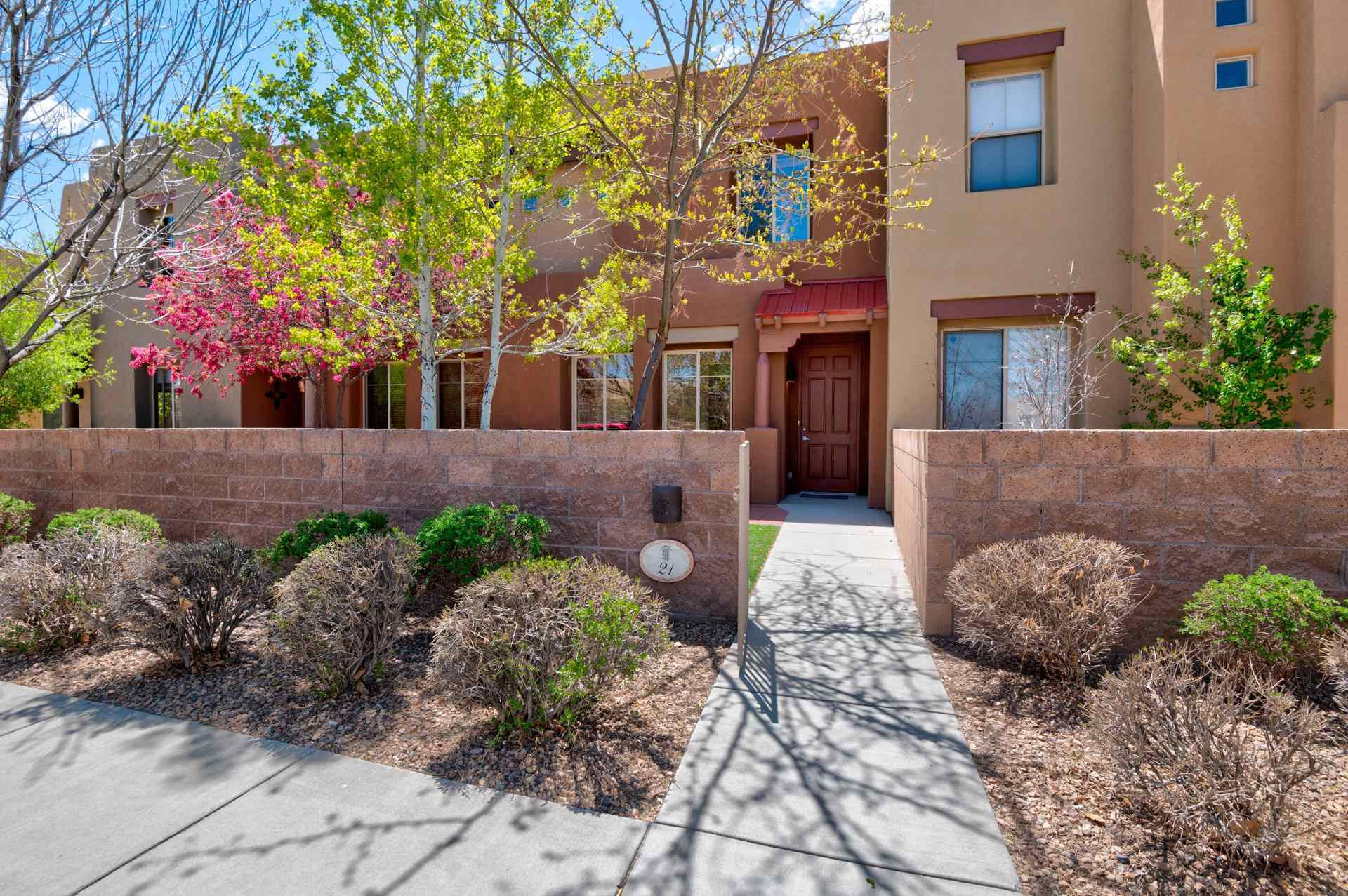 The lovely townhome is light and bright with open living, dining, and kitchen areas on the main level with views out to the landscaped front court yard, bordering the community park. The spacious upper level has a guest bedroom and master bedroom suite that includes a deck and views of the Sangre de Cristos.  Warmth and a welcoming design create the ultimate livable space with a flowing floor plan and functionality. Schedule your showing today!