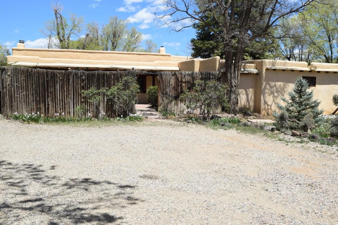 This 2,400 sq.ft. adobe residence with separate 450 sq.ft. office or casita on .44 +/- acres have been a home/office for years. Zoned C-2.so many possible uses in this fantastic location on Cruz Alta just across from Kit Carson Elect .