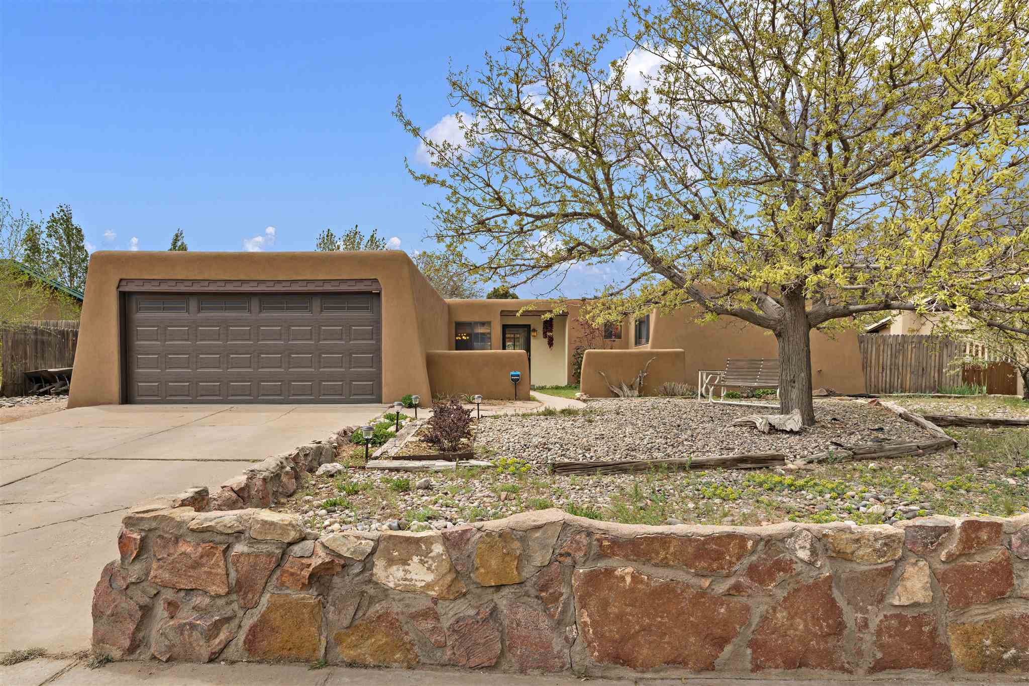 Fabulous finishes with central location. This 4 bedroom/2 bath home already has the walls blown out for an open feel. Granite counters and upgraded cabinets for a lovely, spacious kitchen. Tile floors throughout. 2 car garage.  Do yourself a favor and visit this lovely, easy to see home quickly.