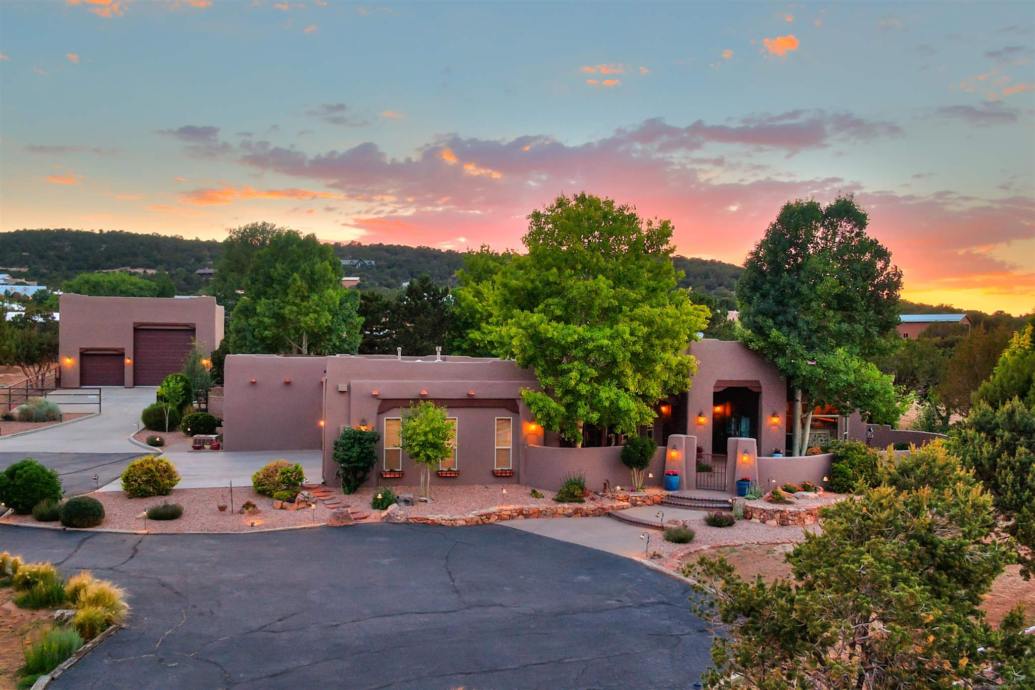 Tucked away in an upscale mountain neighborhood this updated luxury estate enjoys 3586 Sq. Ft. on 4.11 landscaped acres with 4 bedrooms 3 baths, home office and 3 car attached garage with fresh painted floors. Fully fenced with private gated entry, equestrian facilities, RV garage and flex space. Timeless quality with newer roof, stucco, LED lighting and freshly painted making it truly a move-in ready home. An entertaining floorplan complete with formal dining room, family room and open kitchen to easily access the backyard patio. Custom cabinetry, abundant storage, natural wood floors and tile throughout. SW features include vigas, nichos and 2 custom fireplaces. Double ovens, gas stove and beautiful views while you cook make the kitchen the heart of the home. The owners suite features two separate walk-in closets with built-ins, double vanity, jetted tub and separate shower. The guest wing includes three bedrooms adjacent to home office. Horse lovers will enjoy the four stall barn w/ heated tack room, bathroom and shower, upgraded stalls, and easy maintenance feeders/water. Easy trailer entry and exit options.