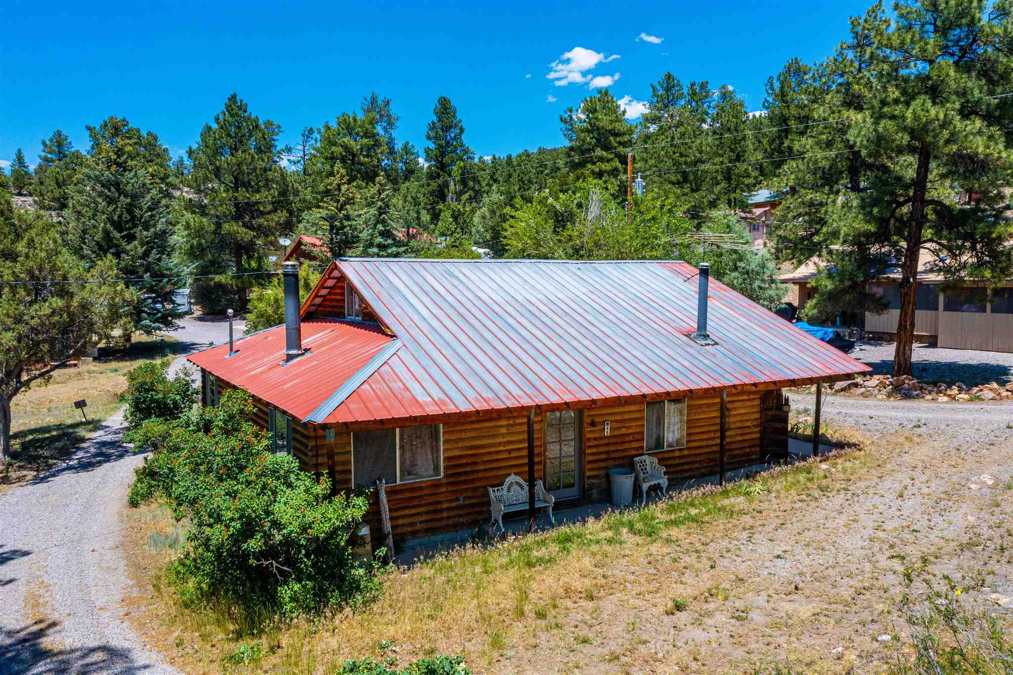 Amazing, cozy cabin situated on beautiful countryside valley. Direct access off of US Highway 64, 20-minutes south of the historic town of Chama, NM.  Equally positioned within a 15-minute drive of the 1.5M acre Carson National Forest to the ease and the Heron and El Vado Lake State Parks to the west.  Santa Fe is +/- 90 minute drive. parcel is generally level with a good combination of native grass meadows and stands of juniper and cedar trees. Spectacular views of mountains and majestic scenery.  Very peaceful property a must see!