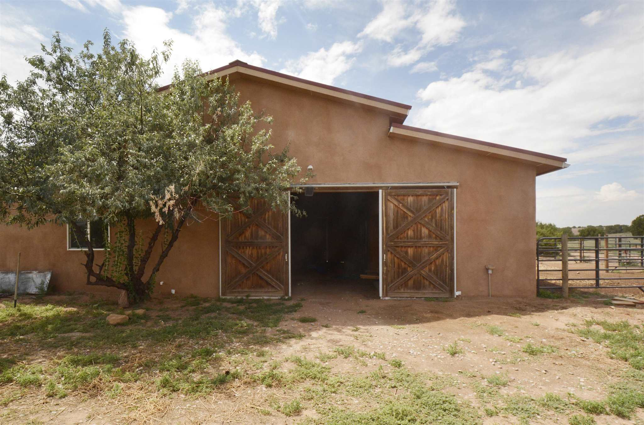 ALL one may want and need for a horse property or family home in the country. 12.5 fully fenced acres provides room to move, stretch and play. 360 degree views afford beautiful New Mexico undisturbed sunrises and sunsets. Ride, hike, bike directly from the property A 1902 sqf home with Saltillo tile throughout, beams and a kiva fire place complete the properties perfection. Comfortable comfortable spaces.  Beautiful pitched roof custom barn (1450 sqf) for horses, shop, studio, or future guesthouse. The possibilities of making this place your dream existence are endless. 25 min. from the Santa Fe Plaza.