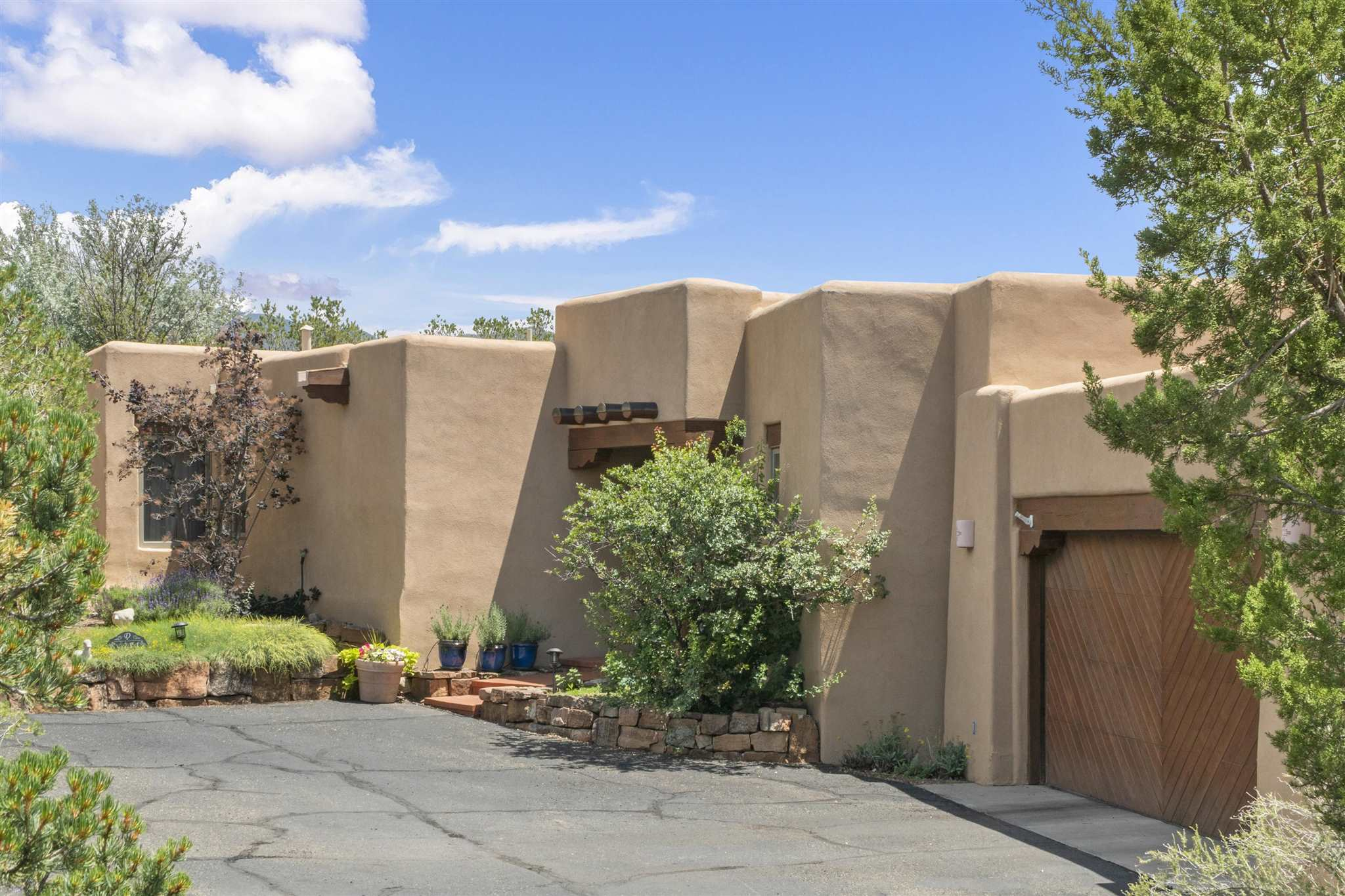 Very sweet home in coveted Las Barrancas northside neighborhood built by John Dieterich as his personal residence, immaculate condition, 2-3 BR, 2B, and darling patio with views.  Features include vigas, kiva fireplace, high ceilings, private location.