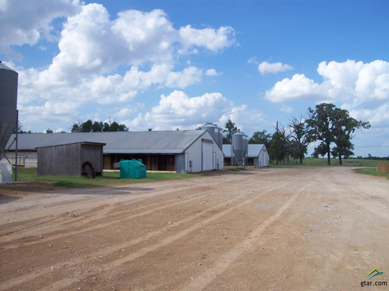 POULTRY FARM FOR SALE 4 40X300 POULTRY HOUSES BUILT IN 1989 AND IN GOOD OPERATING CONDITION ON 11.738 ACRES. CHORE TIME EQUIPMENT AND PLYTHON WATER SYSTEM. 1 WELL AND COMMUNITY WATER. CALL FOR APPOINTMENT TO SEE
