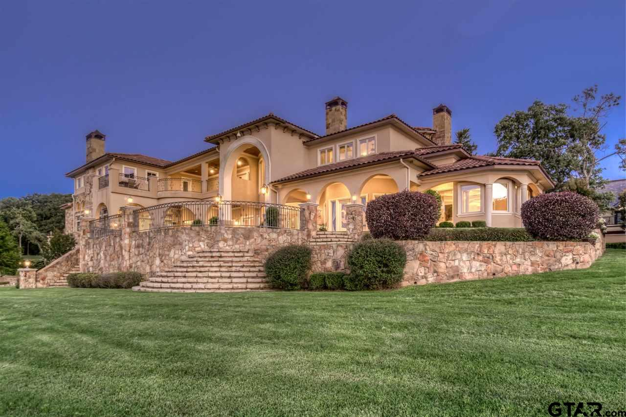 This exquisite 2.059 acre, 5 bedroom, 6 full baths, 3 half baths is the largest waterfront lot at the The Cascades of Tyler and located on Signature Hole #2. Castello Sul Lago boasts a large master suite & grand master bathroom. This sprawling home with generous kitchen, spacious office with library, large game room and a huge patio with a summer kitchen that extends off the family room provides for a unique 3 story dwelling perfect for entertaining. Many more amenities make this home a pleasure including hand painted ceilings, wine cellar, mother-in-law suite,  plentiful closets, generator, hypoallergenic water filtration system, home automation system, safe room, boat house under the home with a canal to the lake and a 6 car garage with a space for golf cart.