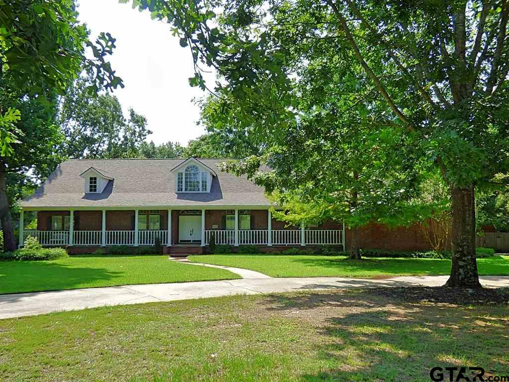 Magnificent front porch welcomes you home and invites your guests to come in and enjoy your home. The great room has a floor to ceiling fireplace and pine floors. This house was built to entertain starting in the great room and continuing into the large kitchen with a huge island that has a Jenn Air gas stove, slate floors, double ovens, a pantry, ample cabinets and granite counter-tops. The game room or office has a full bath and has exits to two decks & the screened in back porch... all overlooking the private lake for the homeowners. There are three bedrooms & two bathrooms down the hall(one is Jack & Jill), large utility room & master suite. The master has room for a sitting area or an office & opens to the screened in back porch. The home features newly installed gutters, siding and roof! The fenced back yard overlooks the lake, has gardening areas and a new storage building. All of this on almost 2 acres and in the Chapel Hill ISD.