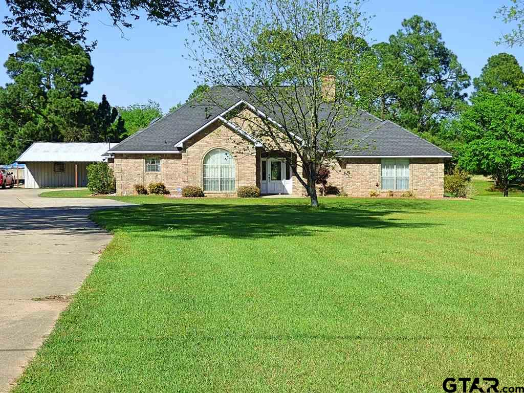 **MOTIVATED SELLER**  ESTATE/COUNTRY LIVING IN CITY LIMITS WITH HIGH SPEED INTERNET SERVICE! Property is surrounded by agriculture land. Convenient to restaurants, shopping, schools and medical facilities. You will appreciate all the natural lighting that is offered throughout the entire home. 2 living areas, large utility room with sink, 3 BR, 2 1/2 BA, kitchen, with abundant cabinets and counter space, skylight over large granite island, eat-in breakfast area, 5 x 7 pantry, electric range/oven, wall oven and a convection microwave. The master en-suite offers two walk-in closets, large shower, and separate tub. 2 guest rooms with walk-in closets, the guest bath has tub/shower combo and floor to ceiling storage cabinets.  Outside, with its own electric meter and HVAC, a 50 x 55 workshop, industrial air compressor, hardwired for welding, 2 lane gun range, 15x20 storage unit and a heated green house. This home and acreage is meticulously maintained and ready for a buyer and/or investor.