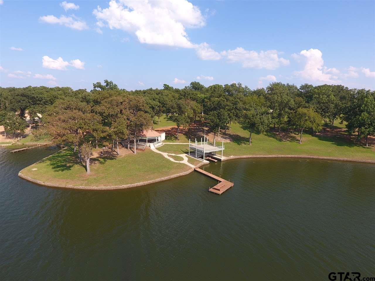 7+ acres of breathtaking waterfront property on the beautiful Lake Bob Sandlin. Property includes a 3bedroom 2bathroom home with plenty of room to build others. Large boathouse with a panoramic view from the upper deck, a gazebo with restrooms, this place is perfect for a large group of people ready to enjoy all of the adventure Lake Bob Sandlin has to offer! Call today for a tour of this property!