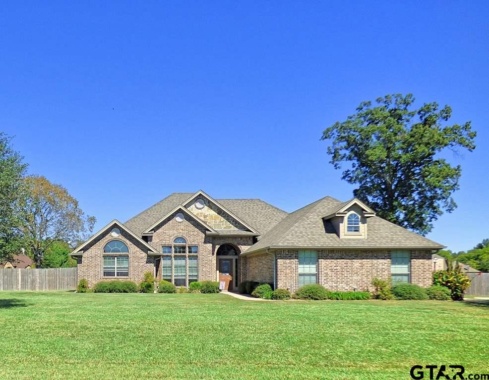 Tranquil living in this one of a kind home located in the Caddo Trace Subdivision!  Fall in love with the unique scored concrete flooring and custom touches throughout the home. The floor plan encompasses 3 spacious bedrooms, 2 bathrooms and a sleek and stylish kitchen that flows through to the breakfast room as well as the living area! Just off the living room is a large formal dining area with large windows ideal for the holidays! The sequestered master bedroom is the ultimate retreat with its high ceilings, recess lighting, private access to the back patio, separate office space and spa-inspired bathroom! Take a step on to the back patio and admire the perfectly manicured and landscaped yard! The 25.2 X 20.2 workshop is the perfect size for crafts & hobbies and features an overhead door! There is plenty of room to expand the patio or to add a pool, the decision is yours! Located in the Chapel Hill ISD, this home will not disappoint, call today for your tour!