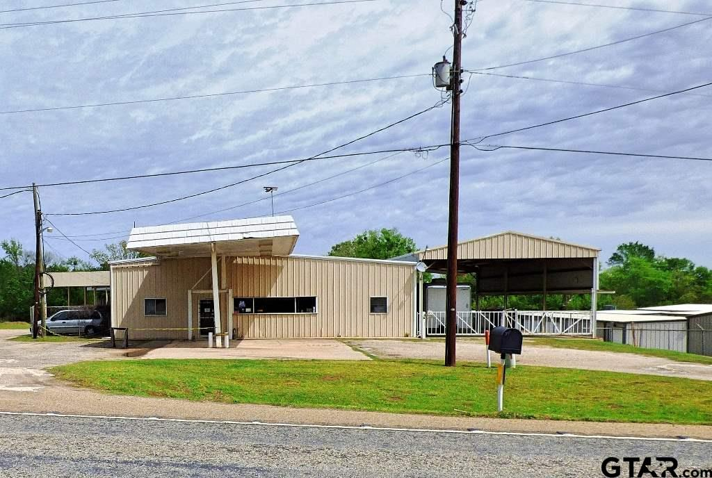 Location, potential, functionality; this building has it all! 2 buildings sitting on 2.44 acres on U.S Hwy 271 approx. 1/2 mile from Interstate 30. The main building is over 11,000 sq. ft. under roof. The 2nd building is approx. 3000 sq. ft. that has been updated with new exterior skin, CH-CA & insulated overhead door in the past 5 years. The main building has heated & cooled area of approx. 3360 with common area 27' X 27', north office 11 X 15, south office 12 X 13, south back office 11 X 13, storage area off office 9 X 5 and garage work area 52 X 30 with 2 overhead doors, canopy on north side of building 55 X 18 Canopy on south side of building 87 X 30. There are 3 curb cuts for driveways on US 271 the 2.44 acres has plenty of room to store equipment.