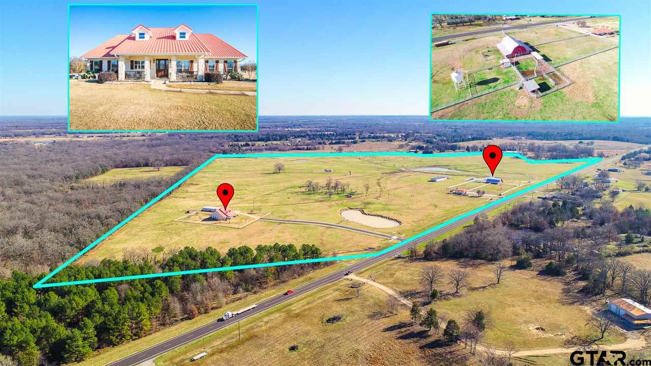 Titus County Landmark!! With over 110 acres of pristine land boasting a main house, rental or second home, and a picturesque barn... This is what ranching dreams are made of! The main property is a 3 bedroom, 2.5 bath dream home featuring a gorgeous open floor plan with fabulous details everywhere you look. There's plenty of room to entertain or host family gatherings especially with the added space in the massive bonus room upstairs. Step outside and enjoy a cup of coffee from your covered back porch and take in your beautiful acreage with 3 ponds or take a walk and enjoy your picture perfect red barn with over 5000 square feet of usable space. Need a little extra income? Or another home for your extended family? There is a spotless 2 bedroom, 2 bathroom bonus house with a separate driveway on the property to use as you would like. This impeccable estate is a dream... and won't last long! Schedule your viewing today!