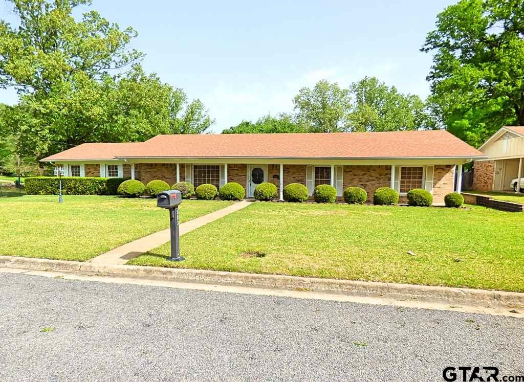 Family friendly! Home features 3 spacious bedrooms and 2 baths with approx. 3,096 sq ft on 1.9 acres in the city. Walk through the entry way into your large open living/kitchen area with a wood burning fireplace. Custom cabinets in kitchen make for ample storage. The openness of the kitchen, living area and formal dining room, makes this the perfect home for family gatherings. Large laundry room with a cedar closet will make doing laundry a breeze. Step out back to your own personal oasis with an in-ground pool, palm trees, pergola and greenery to make every day relaxing. For the gardener of the family there's a greenhouse connected to a storage building. With the extra lots, this home makes it great for any family outdoor activities. PLUS it's in a perfect location with easy access to shopping, schools and family friendly neighborhood.Sitting on almost 2 acres in the city of Mount Pleasant, you can't pass this opportunity by!