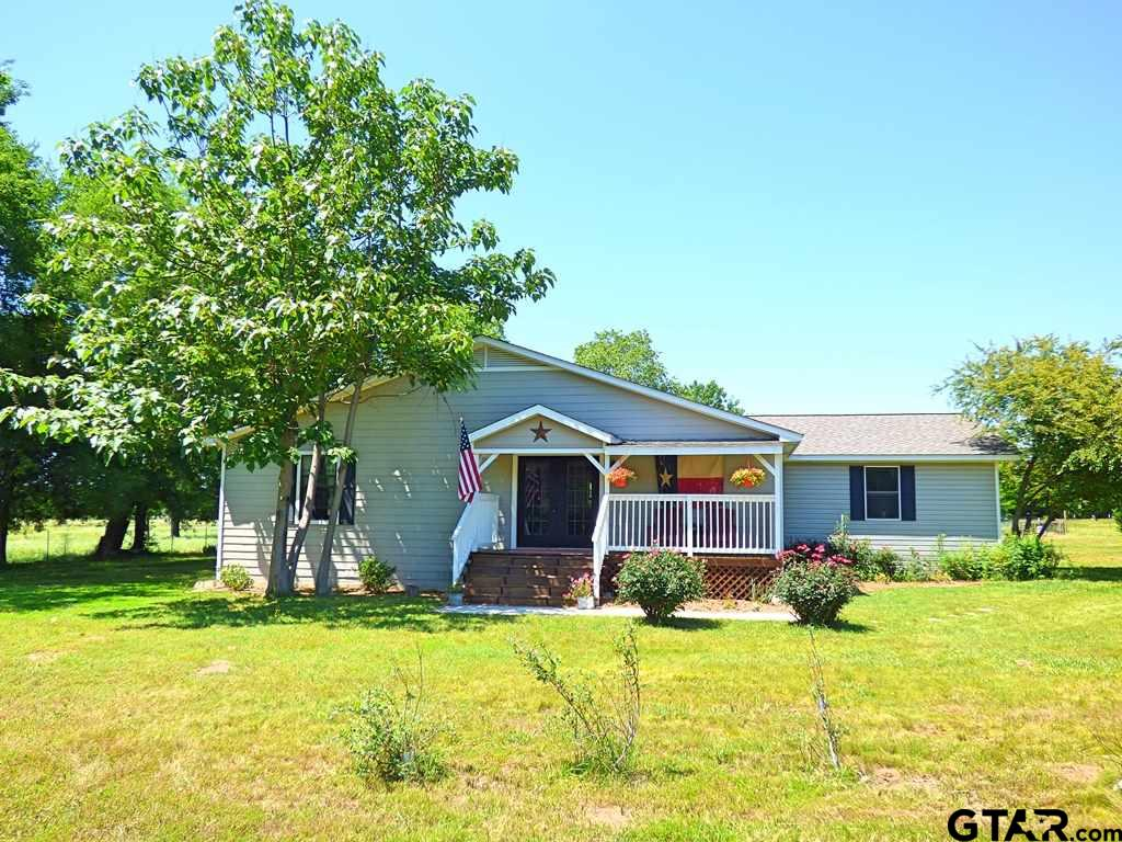 Picture Perfect Farm with over 31 acres!  The minute you pull into the driveway; beautiful scenery in every direction you turn! From the apple, peach and other fruit trees this property is sure to woo you! Freshly remodeled & updated throughout with a contemporary farmhouse look! The huge kitchen was made for entertaining with its island & endless cabinets! We can't say enough about the living area with beautiful plank floors, a ship lap feature wall, wood burning stove & large windows to enjoy the scenic view! Each of the 4 spacious bedrooms and 2 baths have been updated. Acreage has been fenced and cross fenced for livestock. The property features several storage buildings, barns and a large stocked pond, great for your livestock and the wildlife! This property is the perfect sanctuary for goats, chickens, cows, horses and more! The fenced garden yields about 750 lbs of produce. Properties like these don't come around often, add this wonderful East Texas farm to your MUST see list!