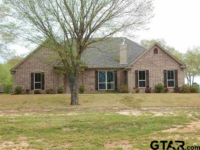 NEW CONSTRUCTION BETWEEN LONGVIEW AND GILMER. BEAUTIFUL 3/2.5/2 BRICK ON A HALF ACRE. GORGEOUS GRANITE COUNTER TOPS, LARGE ISLAND WITH SINK, OPEN FLOOR PLAN, LOTS OF CROWN MOLDING, HIGH CEILINGS, WOOD COLORED TILE FLOORS, FIREPLACE, LARGE ROOMS, LOTS OF STORAGE, BIG MASTER CLOSET, WALK IN SHOWER, NUTURAL COLORS, STAINLESS APPLIANCES, LARGE NICE BACK PORCH, EXTRA BIG GARAGE, LANDSCAPED ON A CORNER LOT. CALL FOR APPOINTMENT.