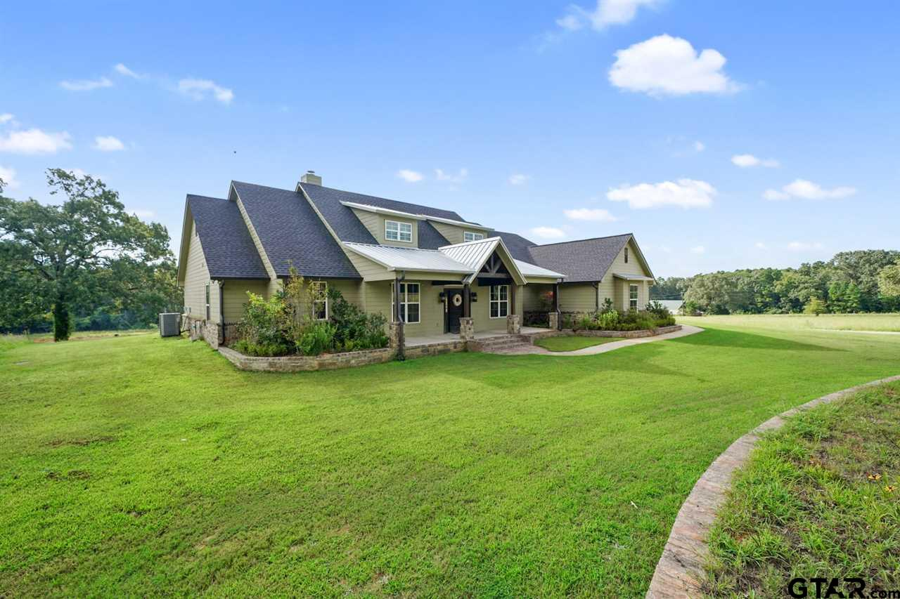 Beautiful 22.247 acre Property in Whitehouse ISD. The Home is 2,969 sqft and offers 4 bedrooms, 3 full baths, 1 half bath, office, large bonus room,  Open Living Room with large fireplace and vaulted ceiling, Open kitchen with custom cabinets, granite counter tops, stone back splash and breakfast bar open to dining area and Living Room. The master suite includes large bedroom with double box ceiling, great bathroom with jetted tub and large walk in shower, Separate vanities, stone counters and a large walk in closet. Large utility room. Stained Concrete floors, great large windows with great views of the property, ceiling moldings and trim work, high ceilings, upgraded light fixtures and much more. Over-sized 3 Car Garage. Large Covered patio overlooking the pond and much more. A must see Property!!!