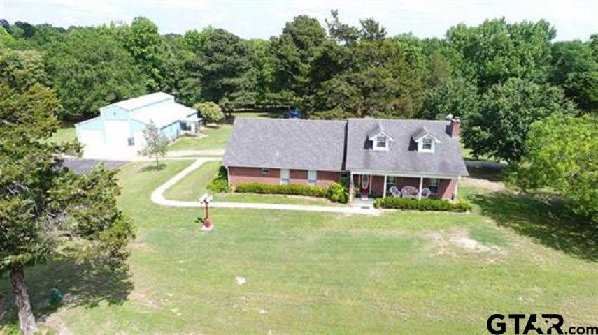 GREAT PRIVATE SECLUDED NEW LISTING ON 8 ACRES. 2 BR PLUS GUEST HOUSE, 3 BATHS, STUDY COULD BE 3RD BR, LARGE OPEN DEN AND KITCHEN WITH SUN ROOM, HUGE COVERED PORCH. HARDWOOD FLOORS IN DEN AND KITCHEN. LARGE SHOP WITH ROOM FOR RV OR MOTOR HOME, 2 CAR GARAGE STALL, WORKSHOP AND 1 BR GUESTHOUSE WITH KITCHEN AND FULL BATH. ADDITIONAL TRACTOR SHED, SMALL LIVESTOCK BARN AND CHICKEN PENS. LANDSCAPED AND LOCATED ON PRIVATE ROAD WITH SECURE ACCESS GATED ENTRY.