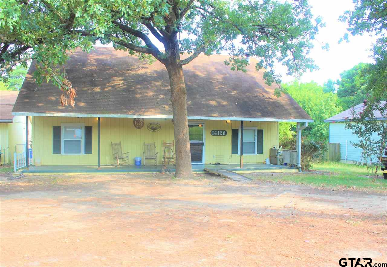 Don't miss this precious home on almost 2 acres in a FABULOUS location! In walking distance to FRESH grocery store, El Charro, playgrounds and many other amenities, this 2 BR/2 BA home offers an open-concept kitchen with a huge island that opens to the living room. The large master bedroom, which is located downstairs and has easy access to the laundry room, offers a walk-in closet with ample storage, as well as its own full bathroom. A loft, which could be used as a study, game room, common area, etc, greets you at the top of the stairs. Around the corner is another large bedroom with a bathroom and closet. Enjoy coffee on the expansive covered front porch or step out to the back porch and enjoy the enormous, fenced backyard. Hardwoods are found throughout the home. This property offers so much house and land for the price! Schedule your private showing today!