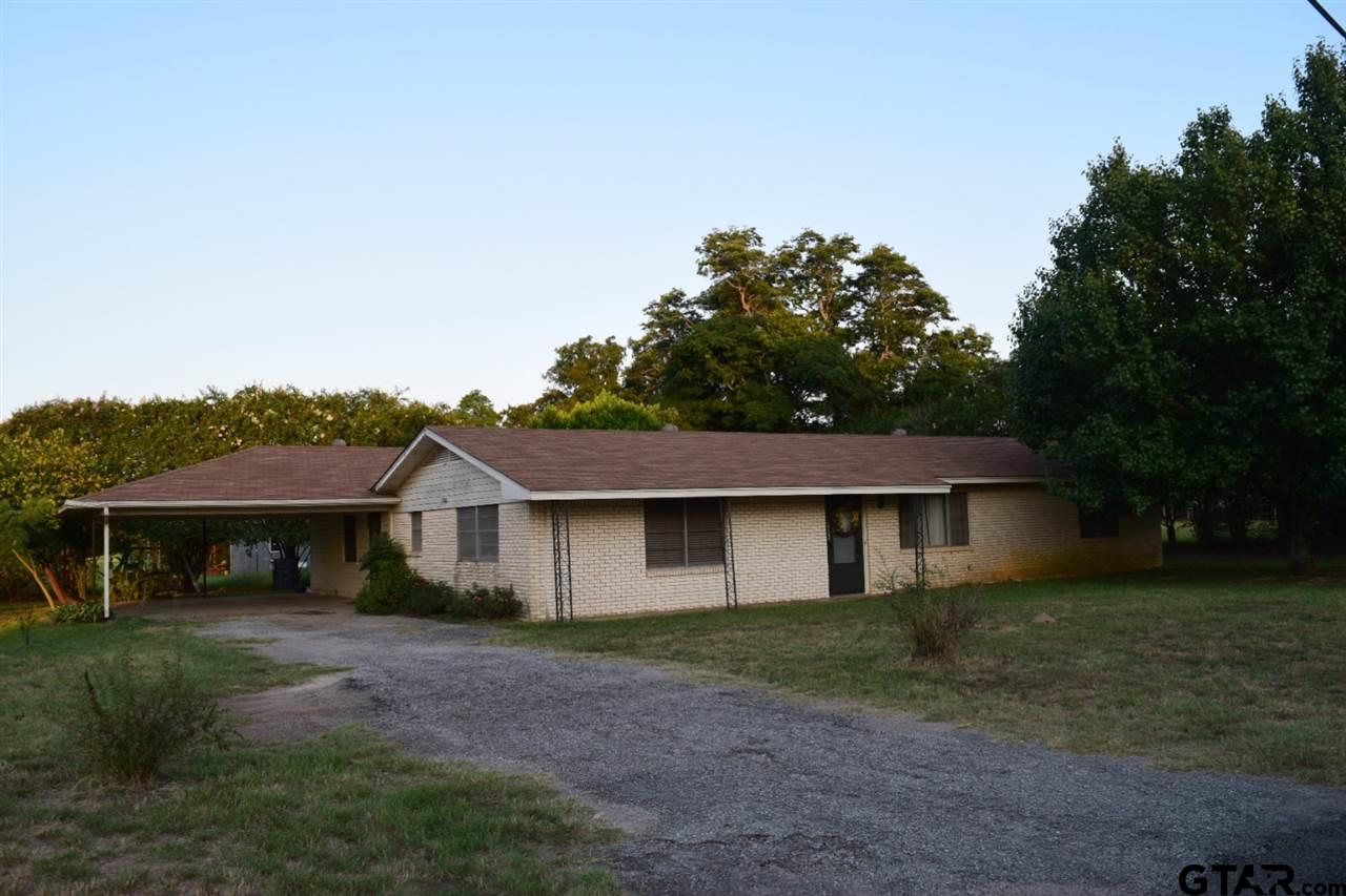 Location! Location! Whether you have been longing to channel your inner Joanna Gaines, Fixer Upper fantasy or just an Investor with a dream, look no further. Ranch style home with lots of potential but needs some TLC. Spacious master bedroom, bathroom with his & hers vanity & walk in closet was added on just off the covered carport entry to make it a 3 bedroom, 2 bath. Washer & dryer in Laundry Room convey.  Large living room just off den could be used as a 4 bedroom or playroom. The 2 guest bedrooms share a hall bath with shower/tub. Breakfast/dining room is just off the Galley Style kitchen which overlooks the fenced in backyard & small covered patio. All carpet has been removed from house. Seller will offer a $2K floor allowance with acceptable offer at closing. Roof is less than 5 years old. Metal shop behind house has a separate drive to the left of the house, approx. 30x30 workshop, covered area to park a boat or rv, as well as a small apartment w/bathroom & kitchen. Conveniently located approx. 10 minutes just outside of Tyler & 4 minutes to Hwy 110 & 346 in Whitehouse.