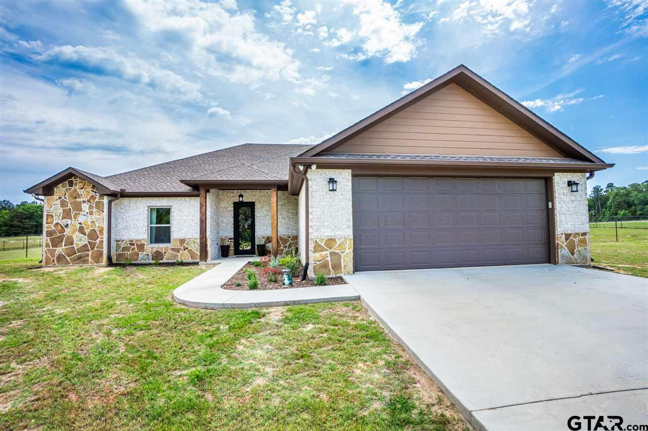 Pottery barn ETX style home, country living, minutes from Gilmer and Longview, large lot with NO RESTRICTIONS for a growing family, home built in 2019 open concept layout with covered patio and fenced back yard for pets & children, timeless trendy finishes ... show stopper!
