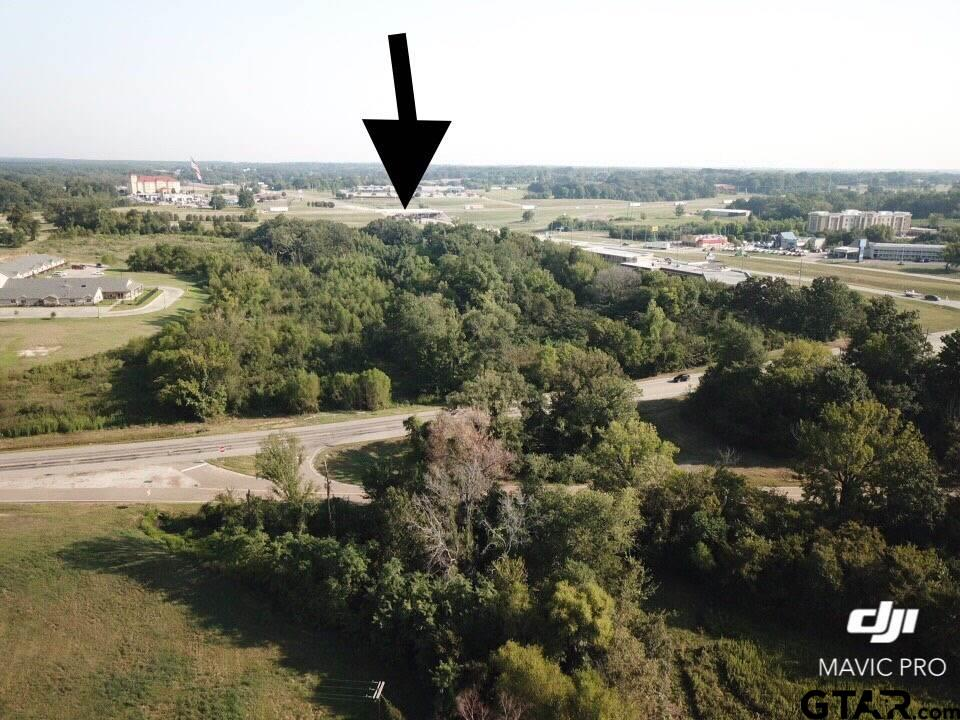 Great business location at the intersection of bypass 271 and Hwy 67 W just south of I-30. The property is neighbored by hotels and restaurants and this location is a very high traffic artery. New commercial construction seems to be trending in this area. This property is priced acknowledging the need for brush clearing and pad site construction.