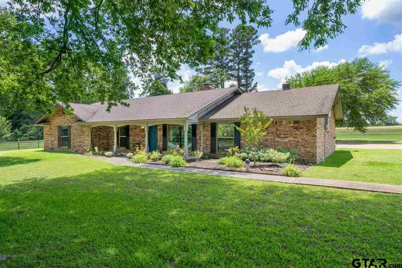 This charming brick home sitting on over 13 acres is an absolute gem. With 3 bedrooms, 2 bathrooms, and a 2 car garage... this home has so much to offer. Boasting a gorgeous brick fireplace in the large living room, granite and granite tile countertops in the kitchen and bathrooms, large windows that fill the entire home with sunlight, and plenty of modern upgrades throughout the home... it's definitely a must see. Then, once you step outside onto your stunning pergola, you can imagine sipping your coffee as you enjoy the peace and quiet of your own 13.6 acre beautiful country retreat. With a multi-level treehouse complete with electricity and a large barn all ready to meet your agricultural needs... this home truly has it all. Schedule you appointment to see this beauty today!